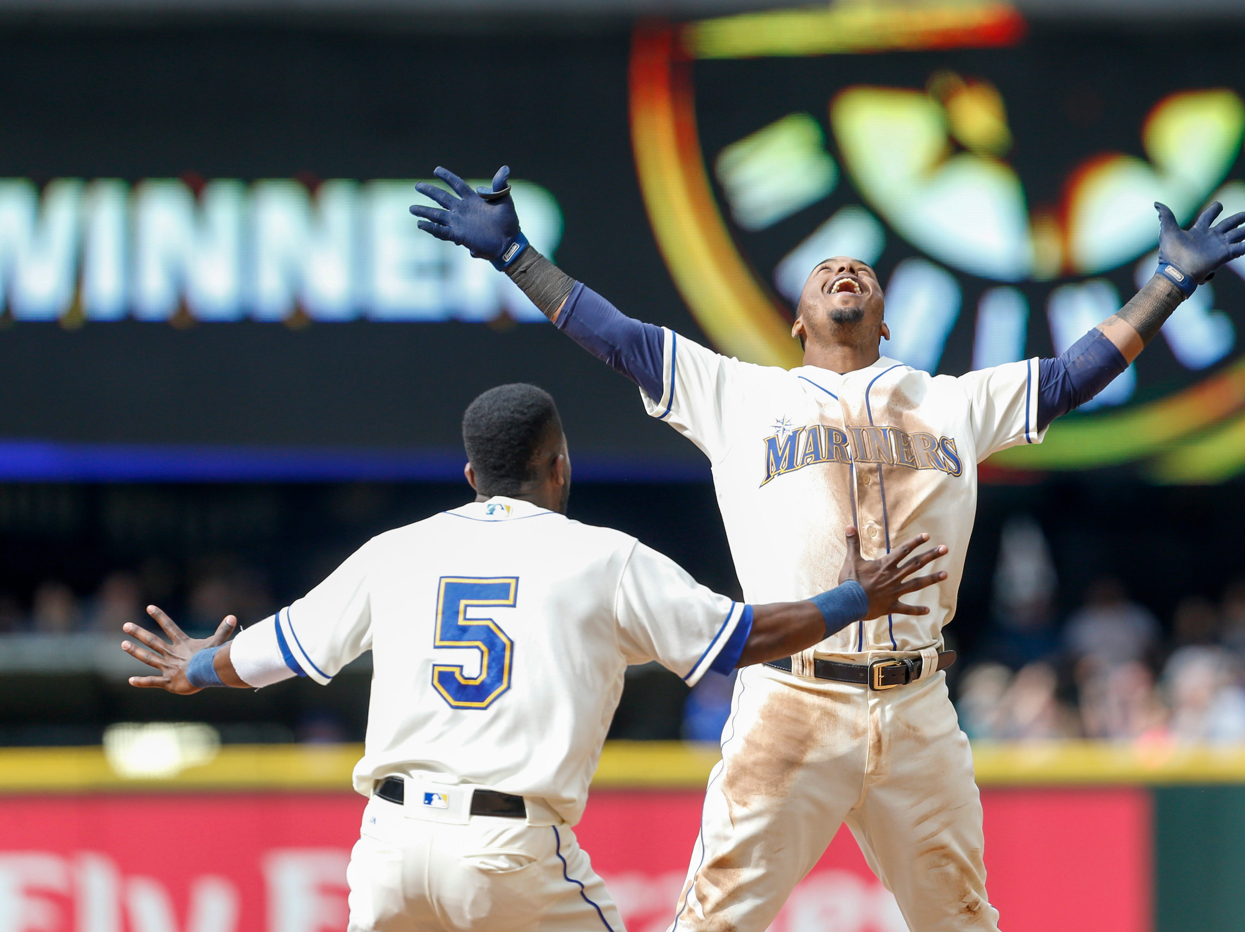 May 20: Seattle Mariners shortstop Jean Segura (2) celebrates after hitting a walk-off single against the Detroit Tigers during the 11th inning at Safeco Field.