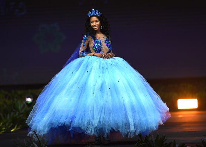 Caitlin Tyson, Miss Cayman Islands 2018 walks on stage during the 2018 Miss Universe national costume presentation in Chonburi province on December 10, 2018. (Photo by Lillian SUWANRUMPHA / AFP)LILLIAN SUWANRUMPHA/AFP/Getty Images ORIG FILE ID: AFP_1BH6II