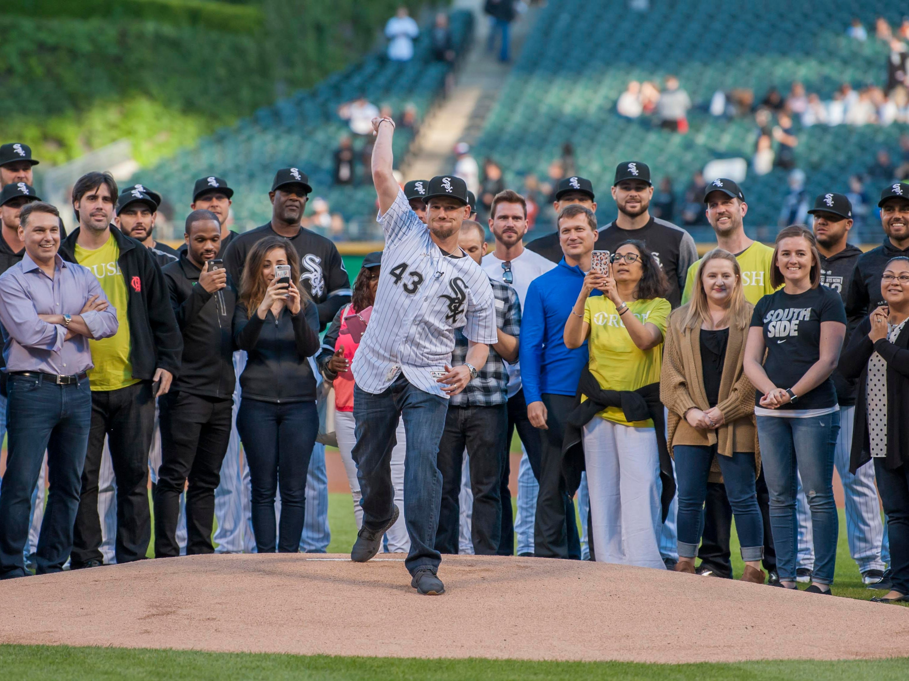 June 1: Chicago White Sox pitcher Danny Farquhar, who suffered a brain hemorrhage earlier in the season, throws out a ceremonial first pitch before a game at Guaranteed Rate Field.