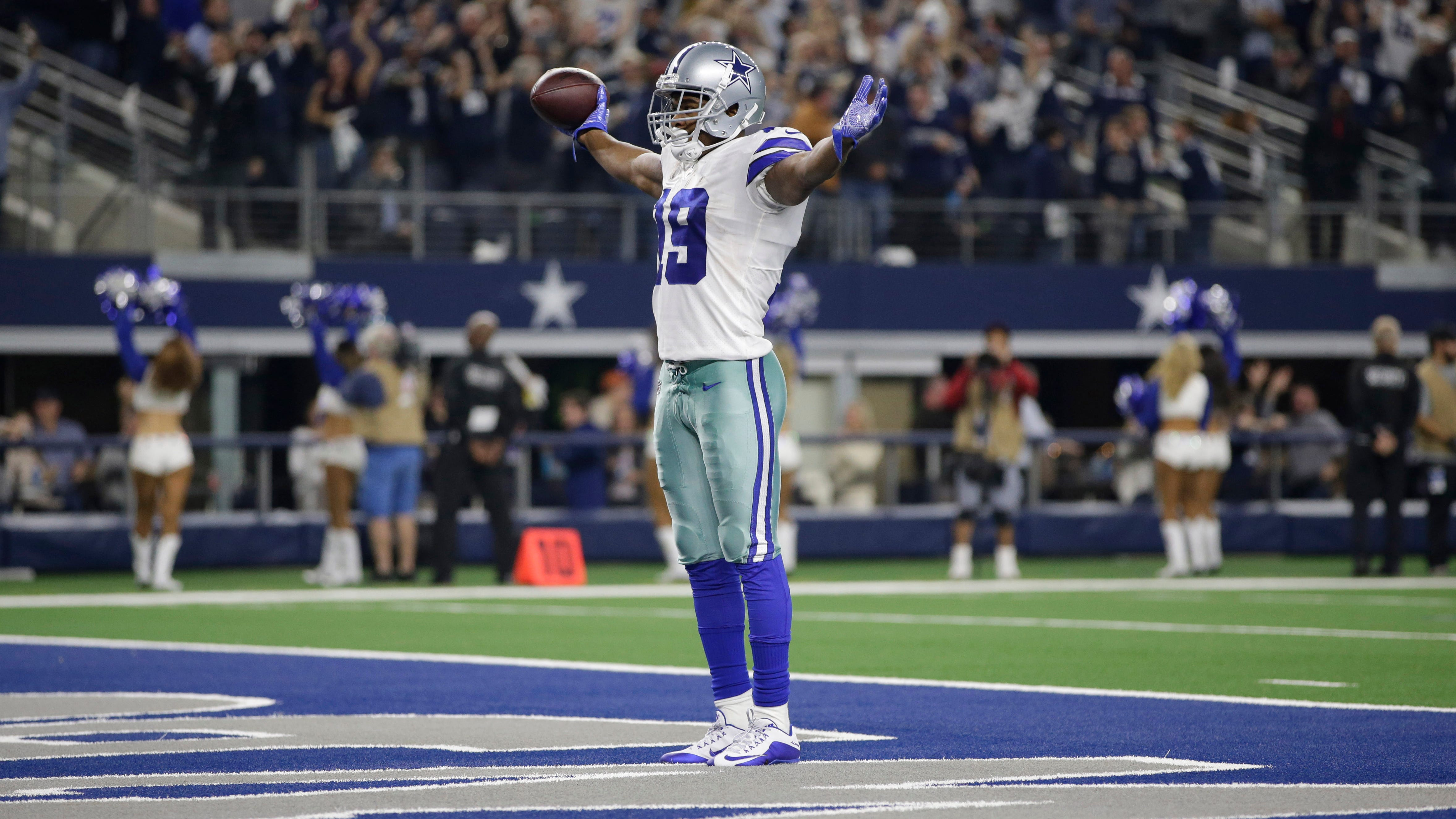Dallas Cowboys wide receiver Amari Cooper (19) celebrates scoring a 75 yard touchdown pass in the fourth quarter against the Philadelphia Eagles at AT&T Stadium.