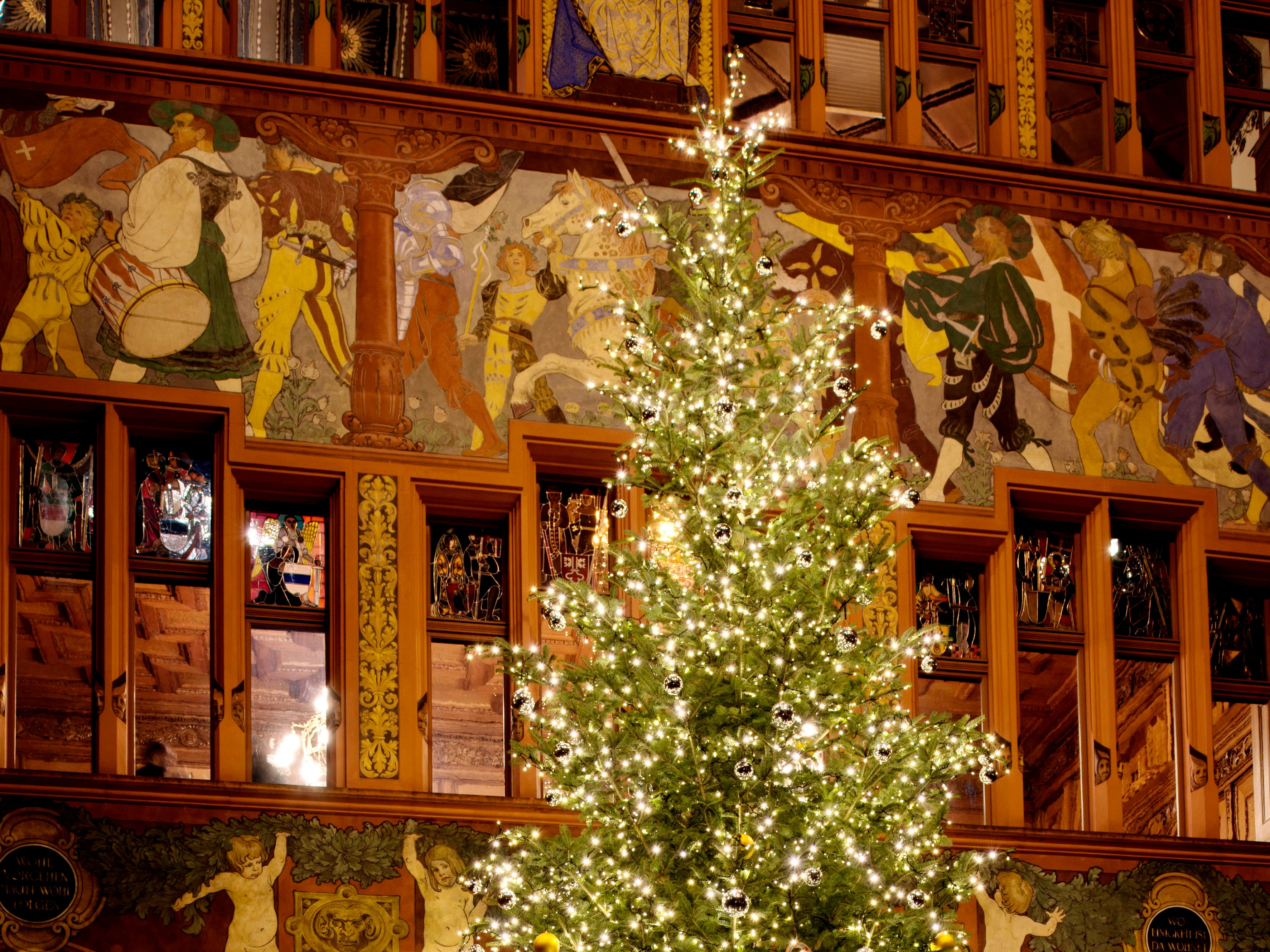 A beautifully lit Christmas tree stands in the City Hall's richly decorated inner court.