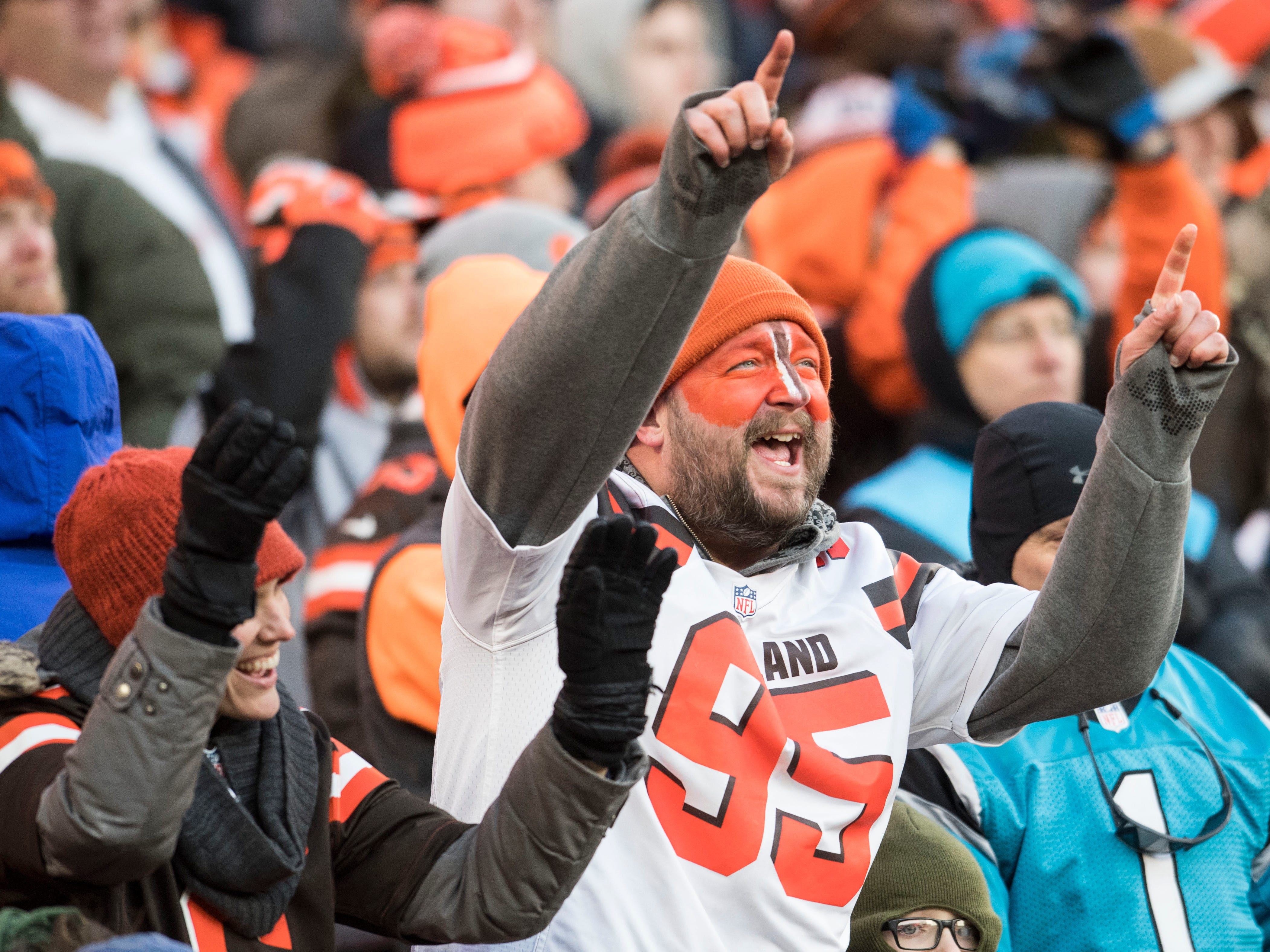 Cleveland Browns fan Brandon Jablonski cheers during the second half against the Carolina Panthers at FirstEnergy Stadium. Mandatory Credit: Ken Blaze-USA TODAY Sports