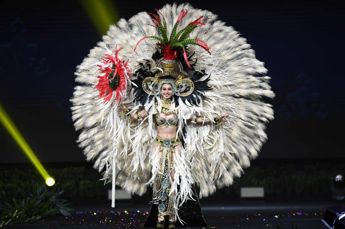 Mariana García, Miss Guatemala 2018 walks on stage during the 2018 Miss Universe national costume presentation in Chonburi province on December 10, 2018. (Photo by Lillian SUWANRUMPHA / AFP)LILLIAN SUWANRUMPHA/AFP/Getty Images ORIG FILE ID: AFP_1BH7PR