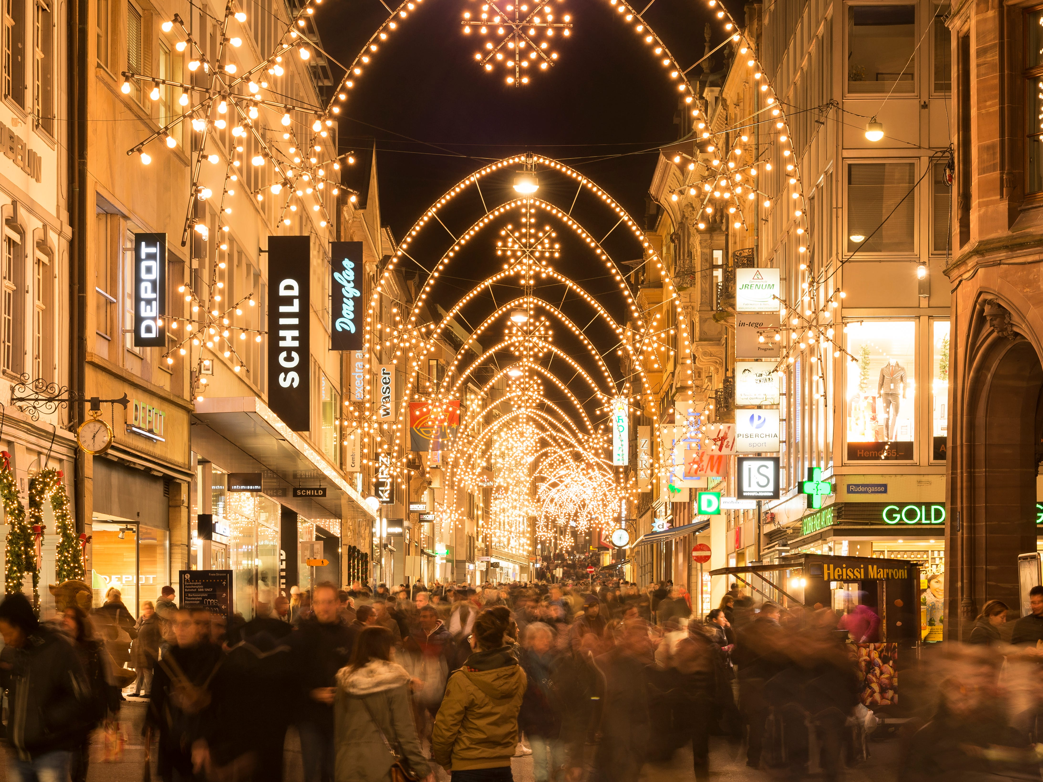A popular Basel shopping street, Freiestrasse, is aglow with thousands of lights.