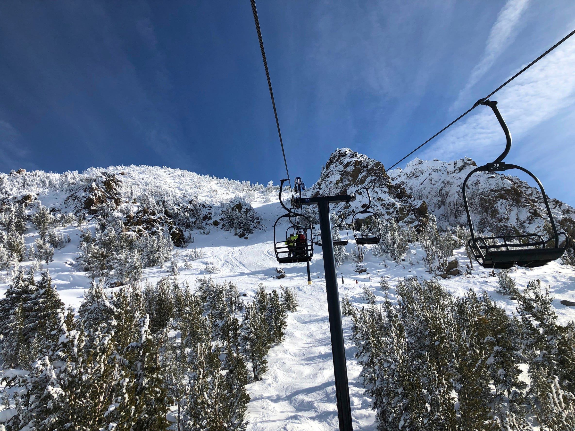 Skiers going up a lift at Mammoth Mountain ski resort in Mammoth Lakes, Calif on Dec. 7.