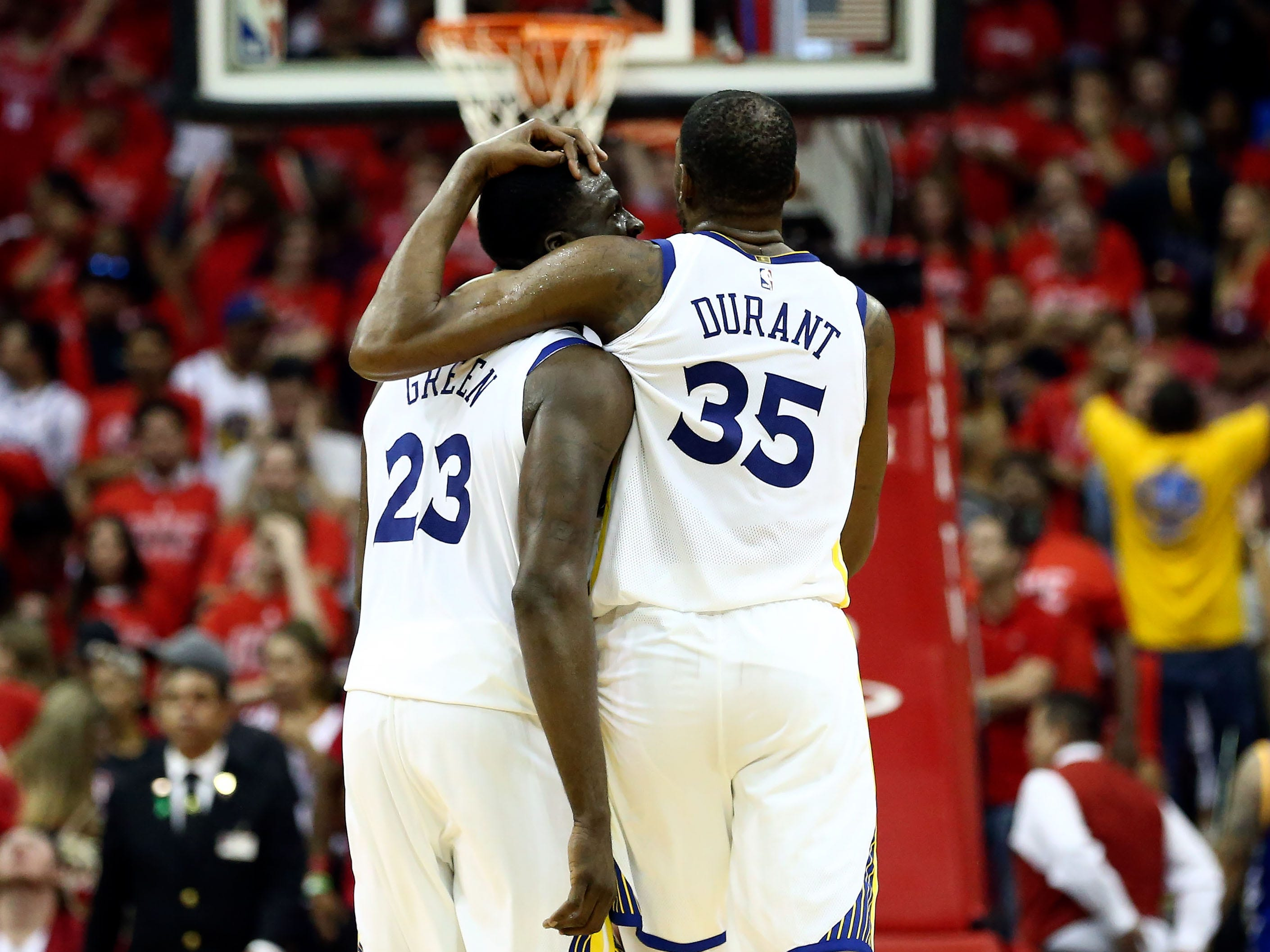 May 28: Golden State Warriors forwards Draymond Green (23) and Kevin Durant (35) hug in the final seconds of their Game 7 win over the Houston Rockets in the Western Conference final.