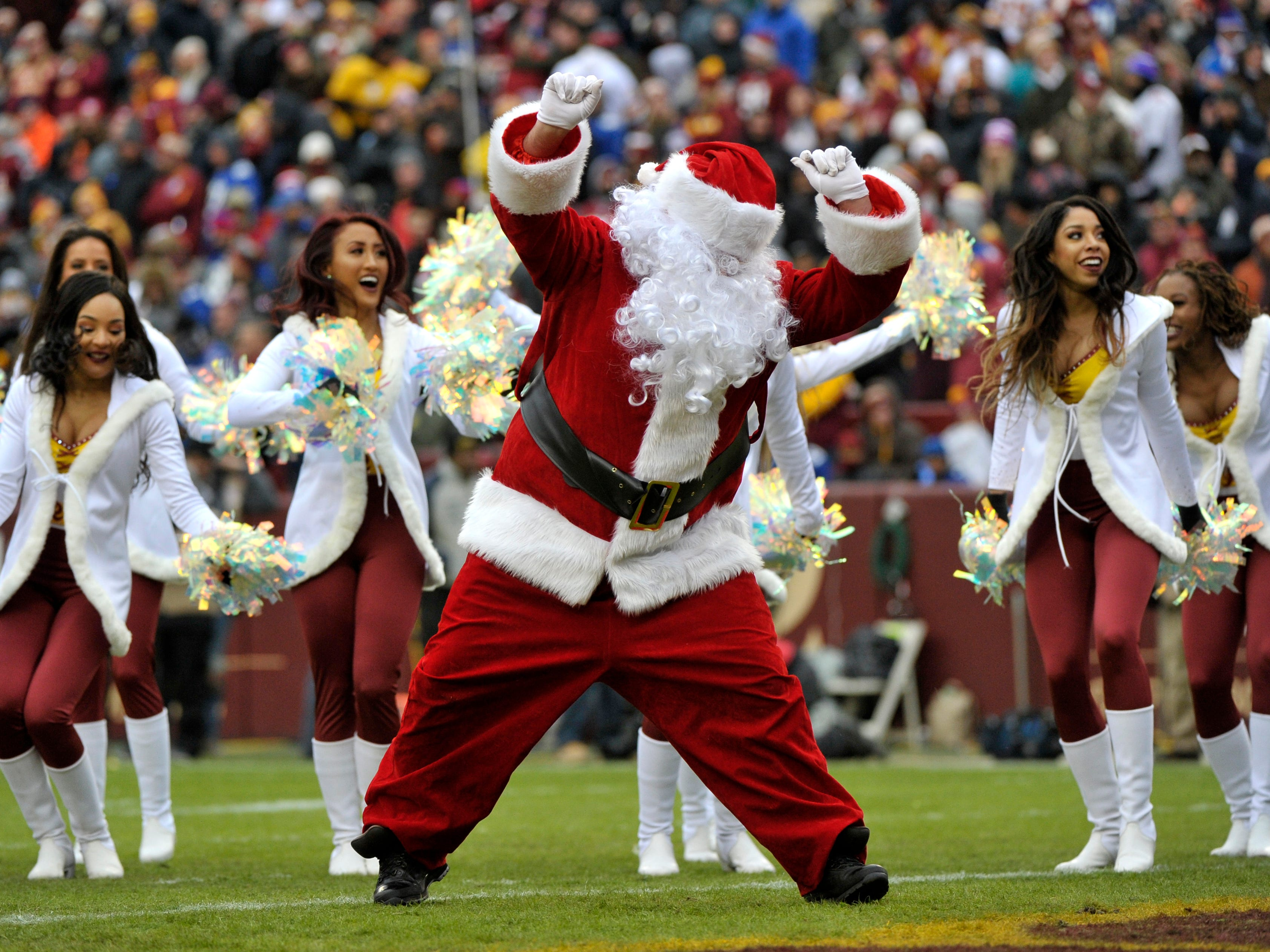 Washington Redskins cheerleaders perform with Santa Claus during an NFL football game between the New York Giants and Washington Redskins,  Dec. 9, 2018, in Landover, Md. T: OTK146