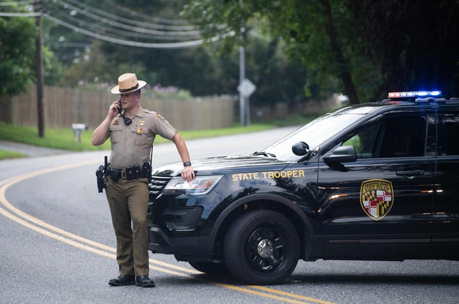 Police block off roads near the location of a shooting in Aberdeen, Maryland, in September. Aberdeen police recently completed an investigation related to a school shooting threat at Aberdeen Middle School, determining it was a hoax. Two students have been charged.