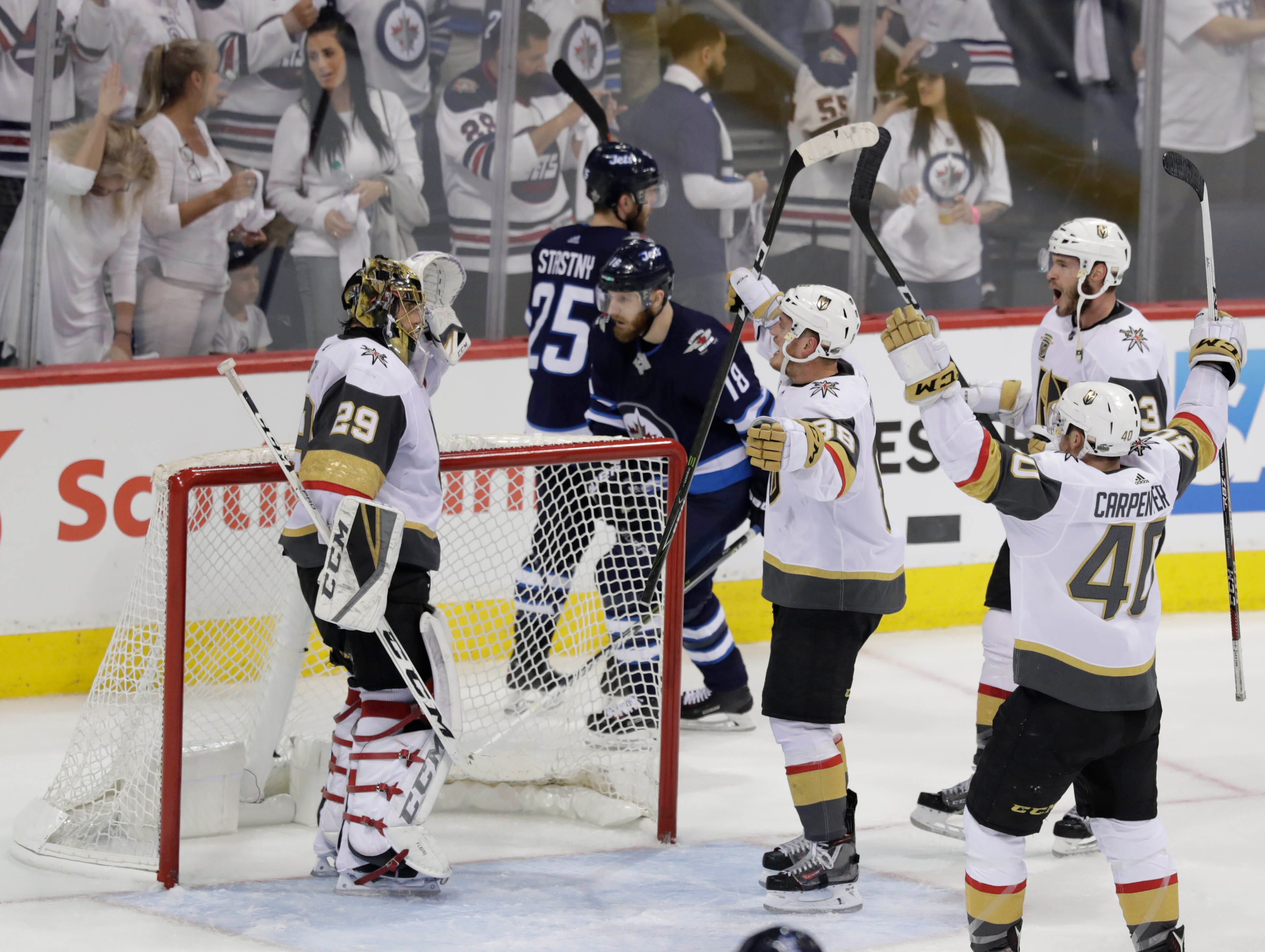 May 20: Vegas Golden Knights goaltender Marc-Andre Fleury (29) celebrates with his teammates after defeating the Winnipeg Jets in Game 5 to win the Western Conference.
