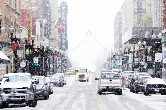 Snow flurries fall on Gay St. in Knoxville, Tenn. on Dec. 9.