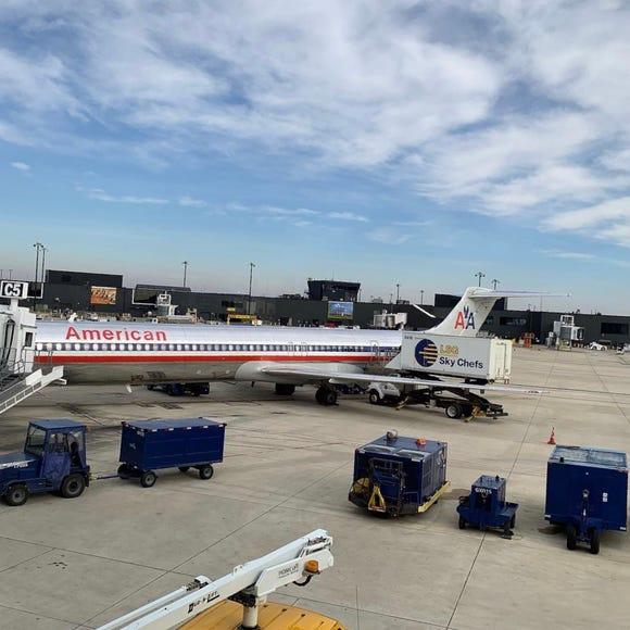 An American Airlines MD-80 jet is seen at Baltimore/Washington International Airport on Saturday, Dec. 8, 2018.
