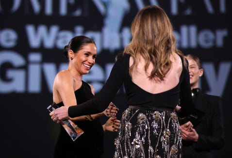 The Duchess of Sussex joined Rosamund Pike, back right, to present Givenchy creative director Clare Waight Keller with the British Designer of the Year Womenswear honor.