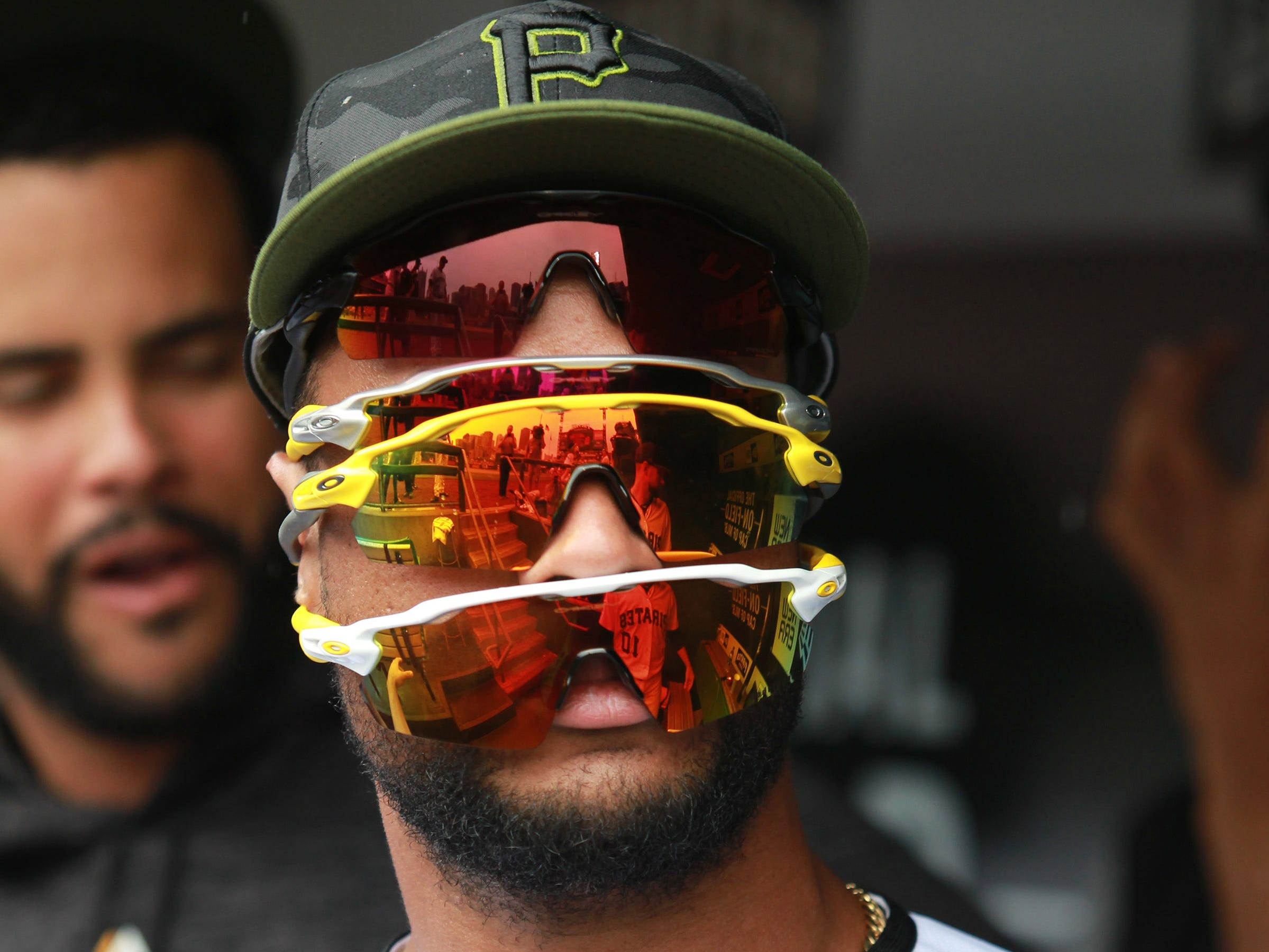 May 26: Pittsburgh Pirates catcher Elias Diaz wears multiple pairs of sunglasses in the dugout before playing the St. Louis Cardinals at PNC Park.