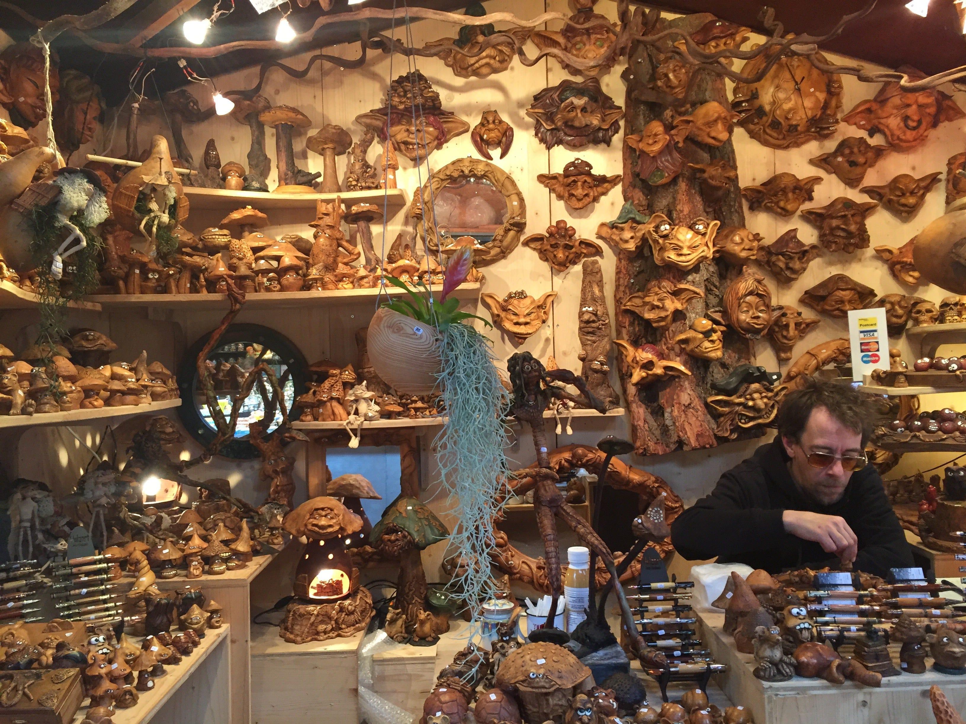 A booth at Barfüsserplatz displays hand-carved wooden figurines.