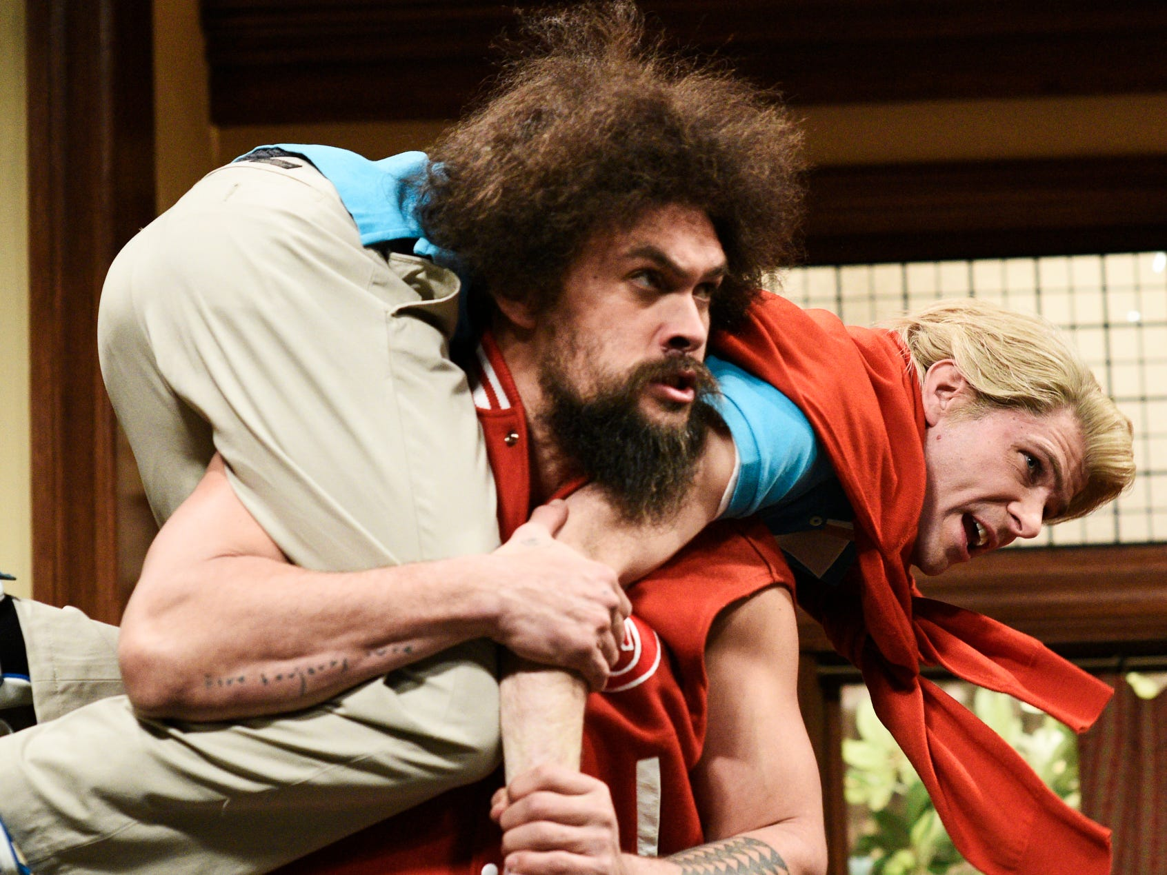 Momoa (holding Mikey Day) also played Beef, a jock with anger management issues, in a parody of 1980's nerd movies.