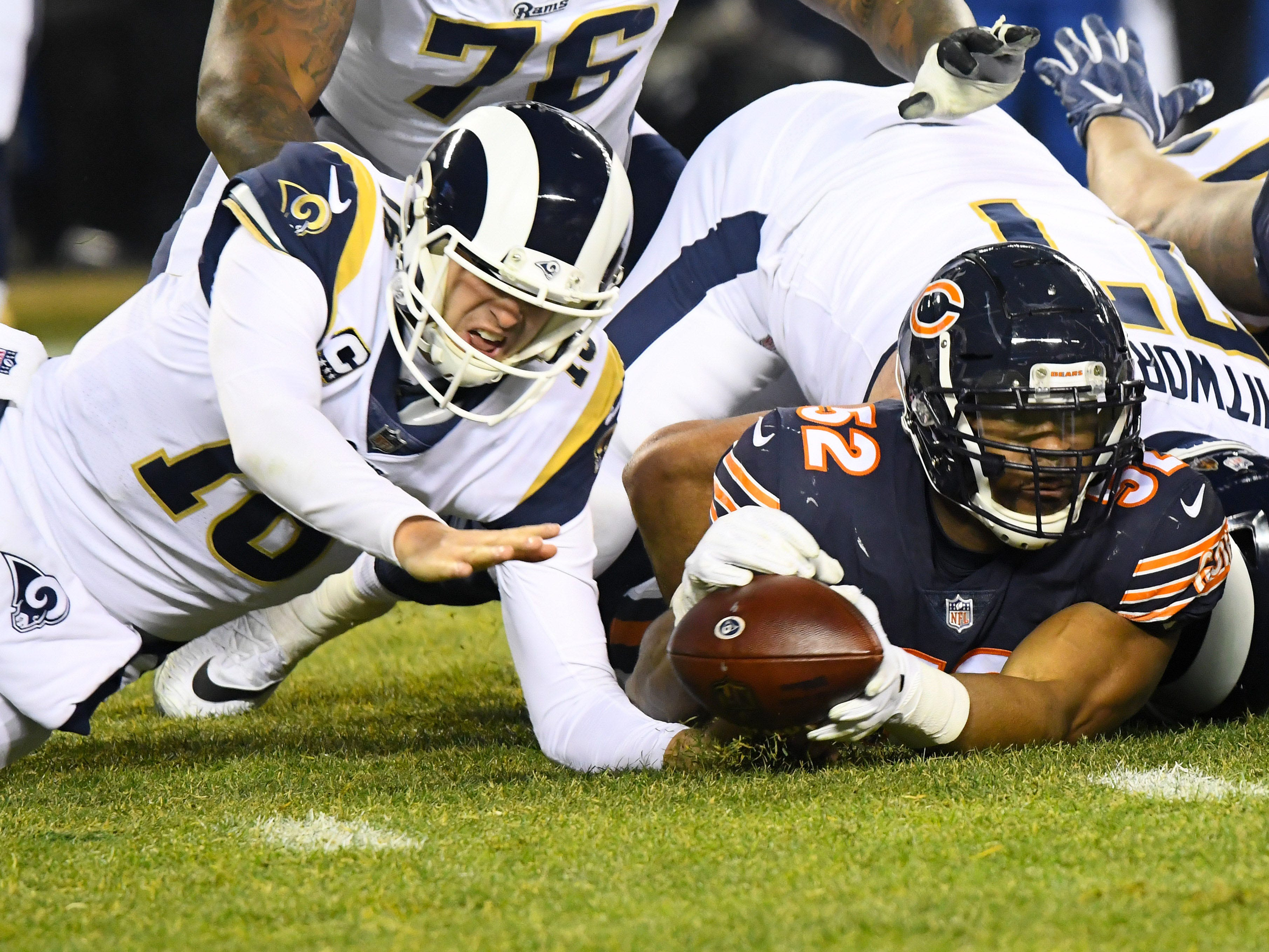 Los Angeles Rams quarterback Jared Goff and Chicago Bears linebacker Khalil Mack dive for a fumble during the second half at Soldier Field.