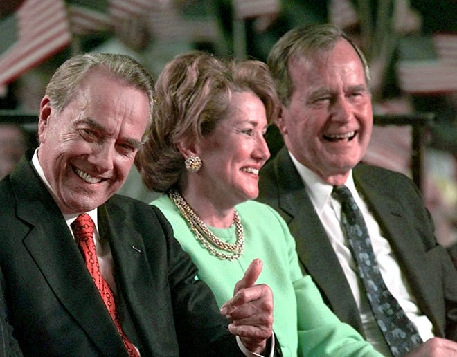 Bob and Elizabeth Dole with George H.W. Bush in Grand Rapids, Michigan, on Nov. 1, 1996.