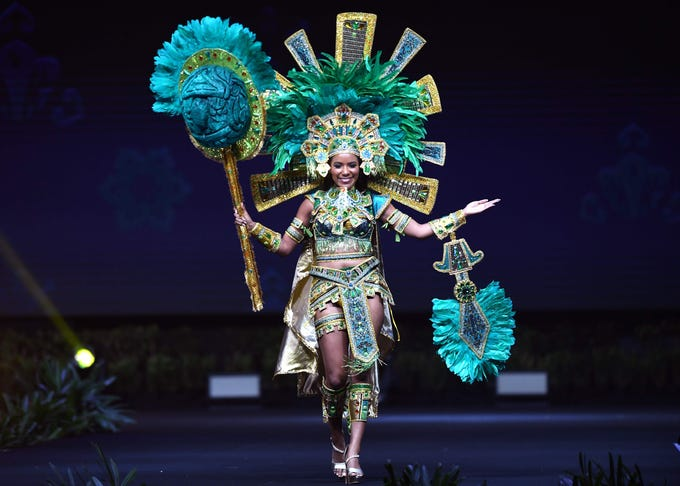 Jenelli Fraser, Miss Belize 2018 walks on stage during the 2018 Miss Universe national costume presentation in Chonburi province on December 10, 2018. (Photo by Lillian SUWANRUMPHA / AFP)LILLIAN SUWANRUMPHA/AFP/Getty Images ORIG FILE ID: AFP_1BH7JW