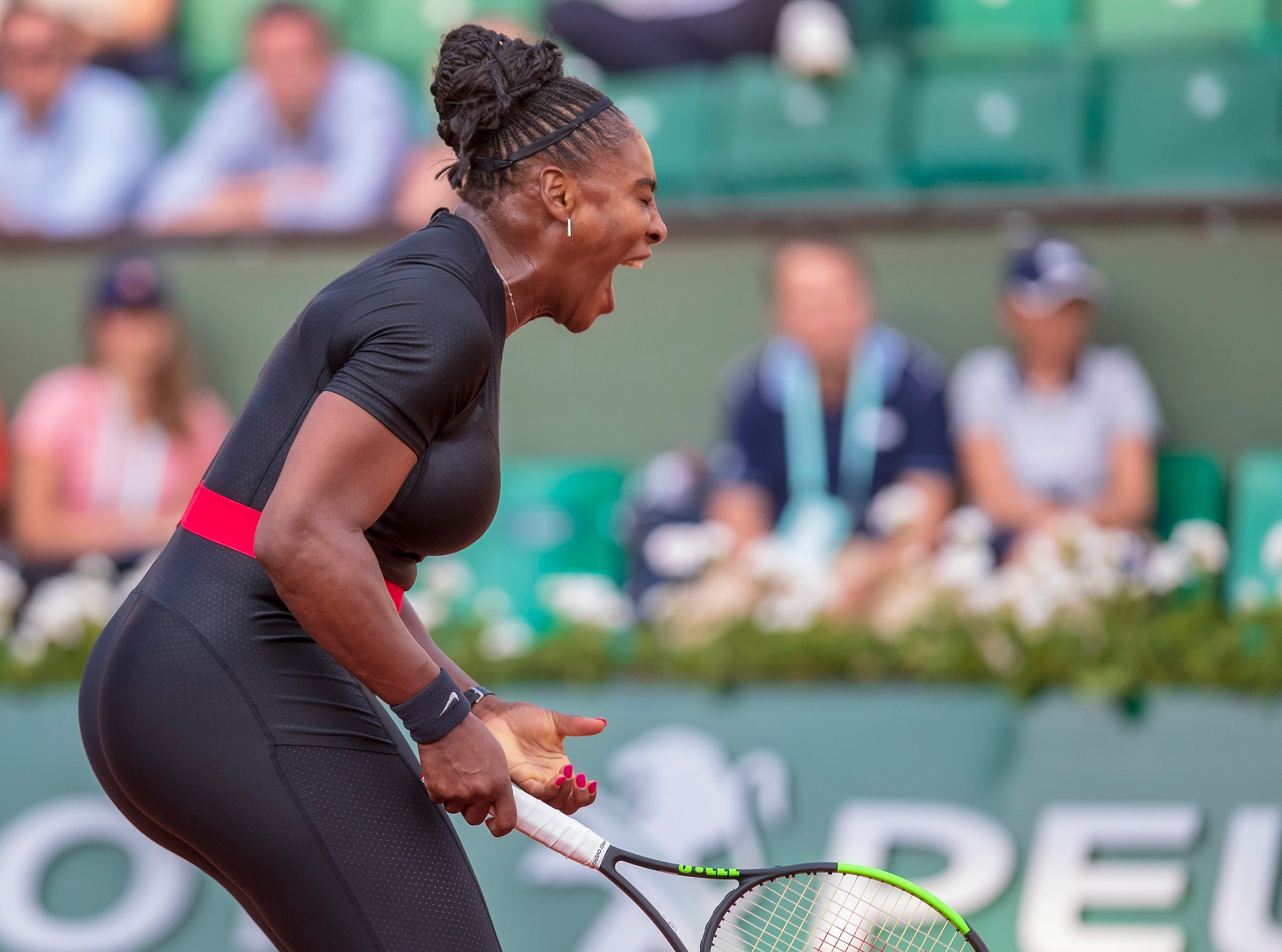 May 31: Serena Williams (USA) reacts during her match against Ashleigh Barty (AUS) on Day 5 of the French Open.