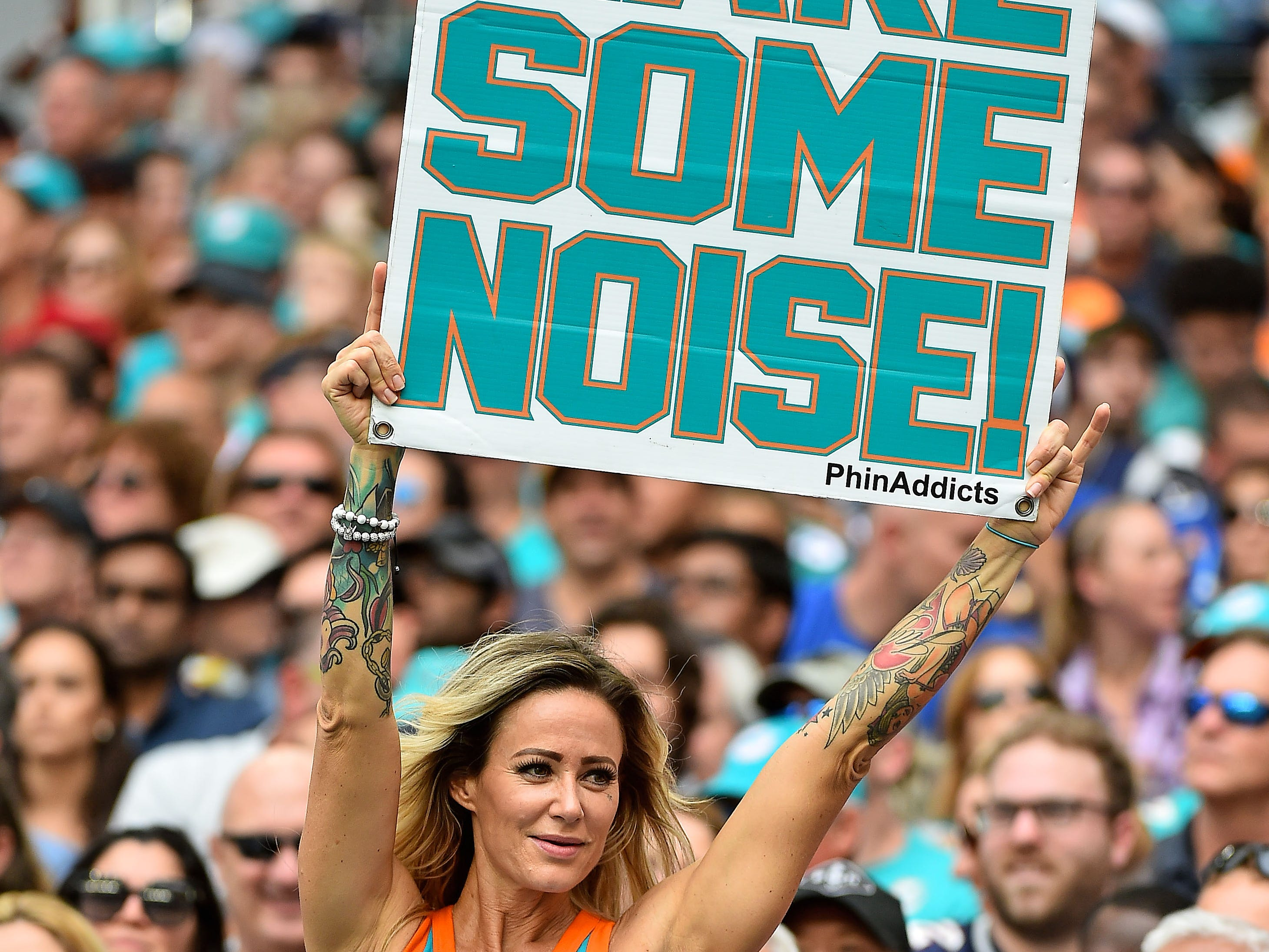 A Miami Dolphin fan cheers during the first half between the Miami Dolphins and the New England Patriots at Hard Rock Stadium.