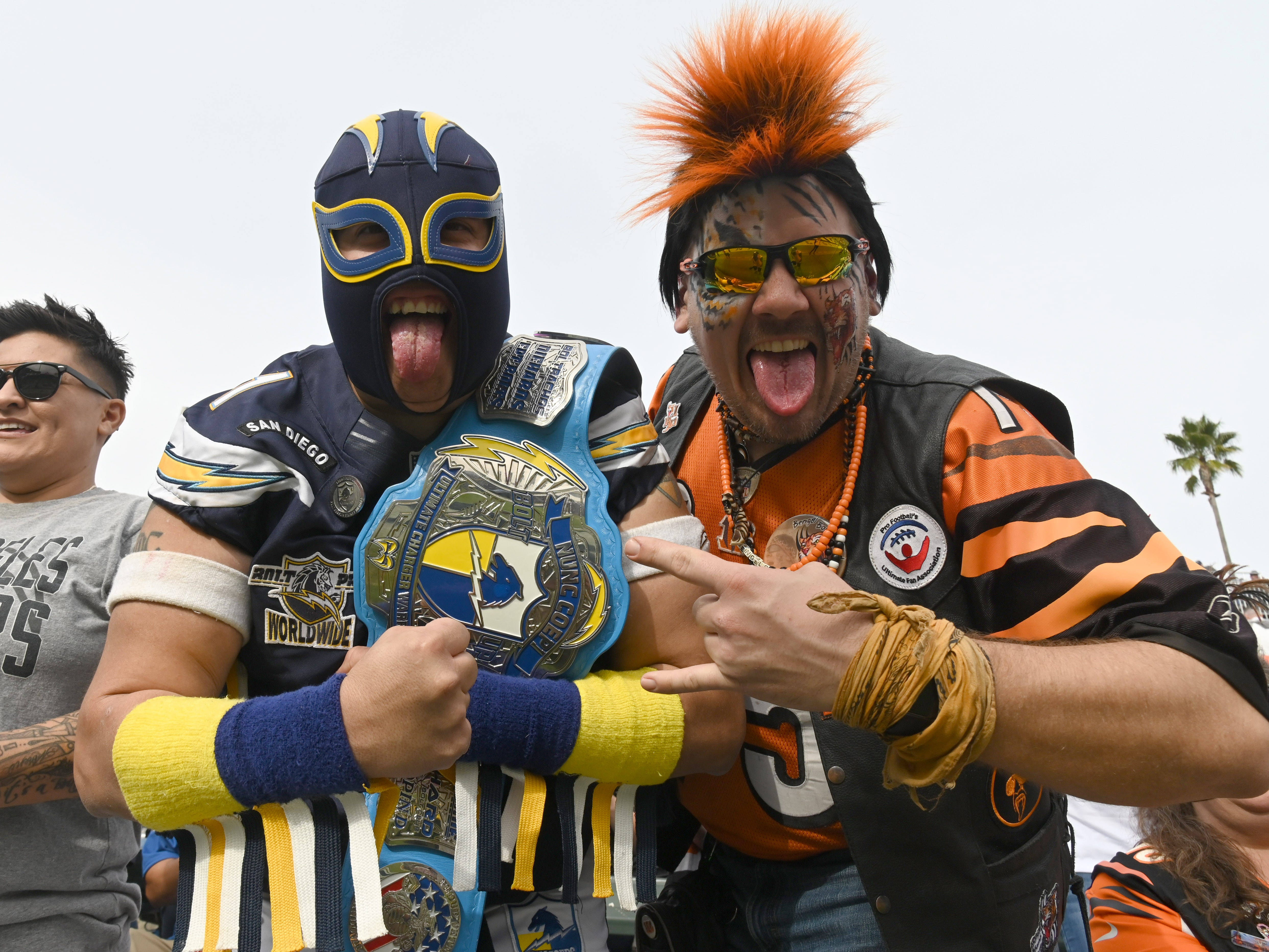 Los Angeles Chargers and Cincinnati Bengals fans pose during the second quarter at StubHub Center.