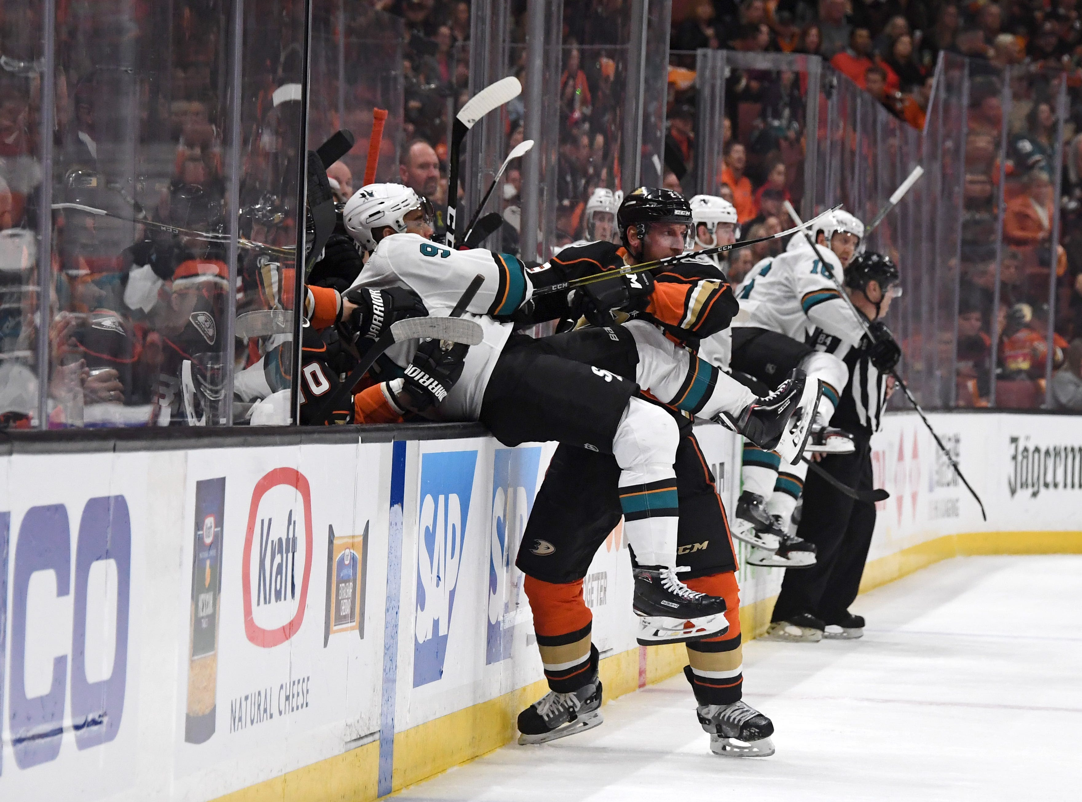 April 14: Anaheim Ducks defenseman Francois Beauchemin (23) shoves San Jose Sharks left wing Evander Kane (9) into the bench in the first period in Game 2 of their first-round series.