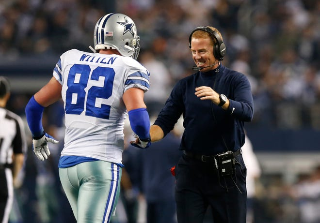 Dallas Cowboys tight end Jason Witten (82) celebrates with head coach Jason Garrett after scoring a touchdown in the third quarter against the Indianapolis Colts at AT&T Stadium.