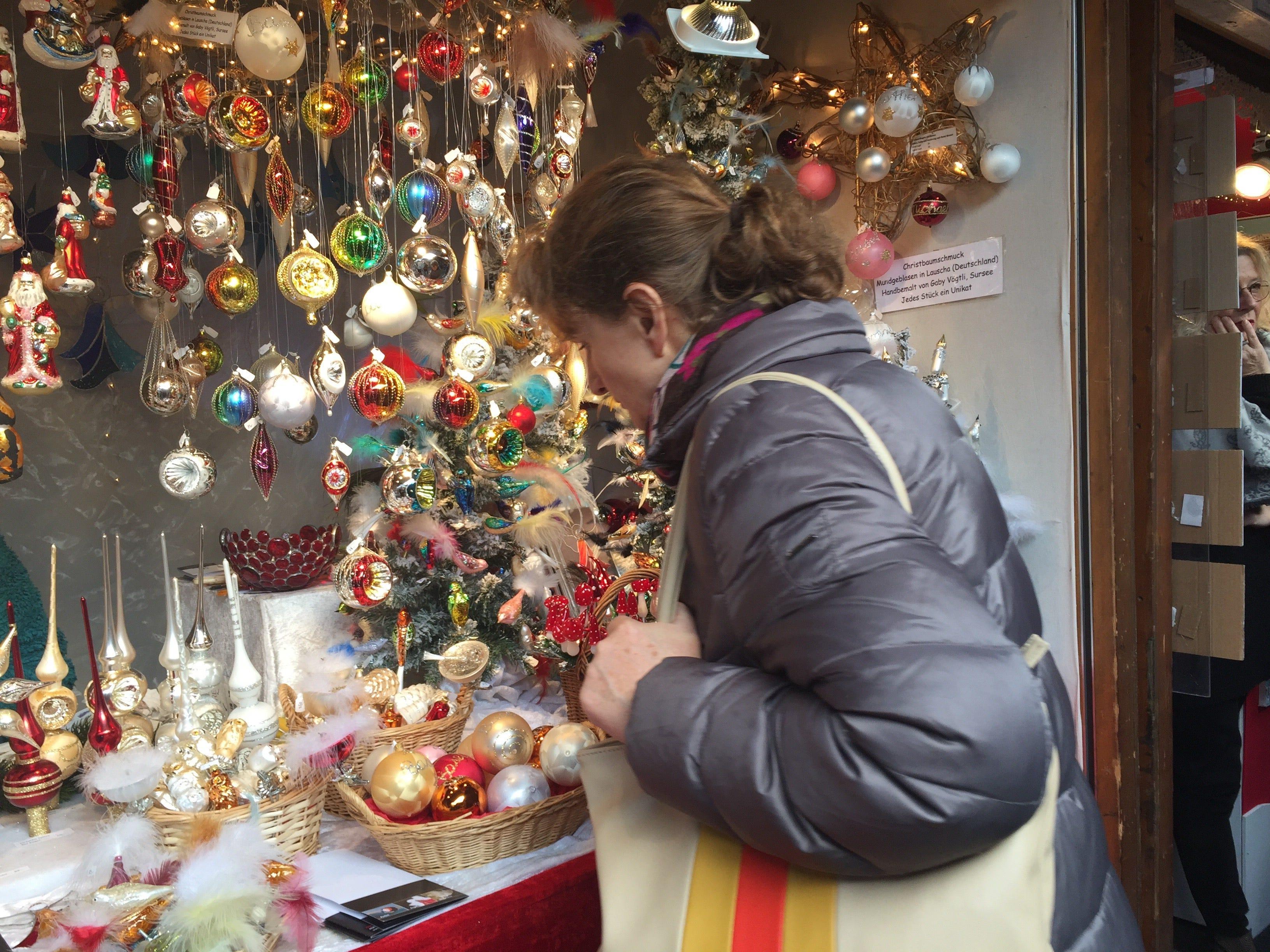 Shoppers admire hand-made tree ornaments at Barfüsserplatz.