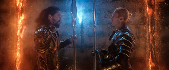 "Arthur (Jason Momoa, left) squares off with his half-brother, Orm (Patrick Wilson), in ""Aquaman."""
