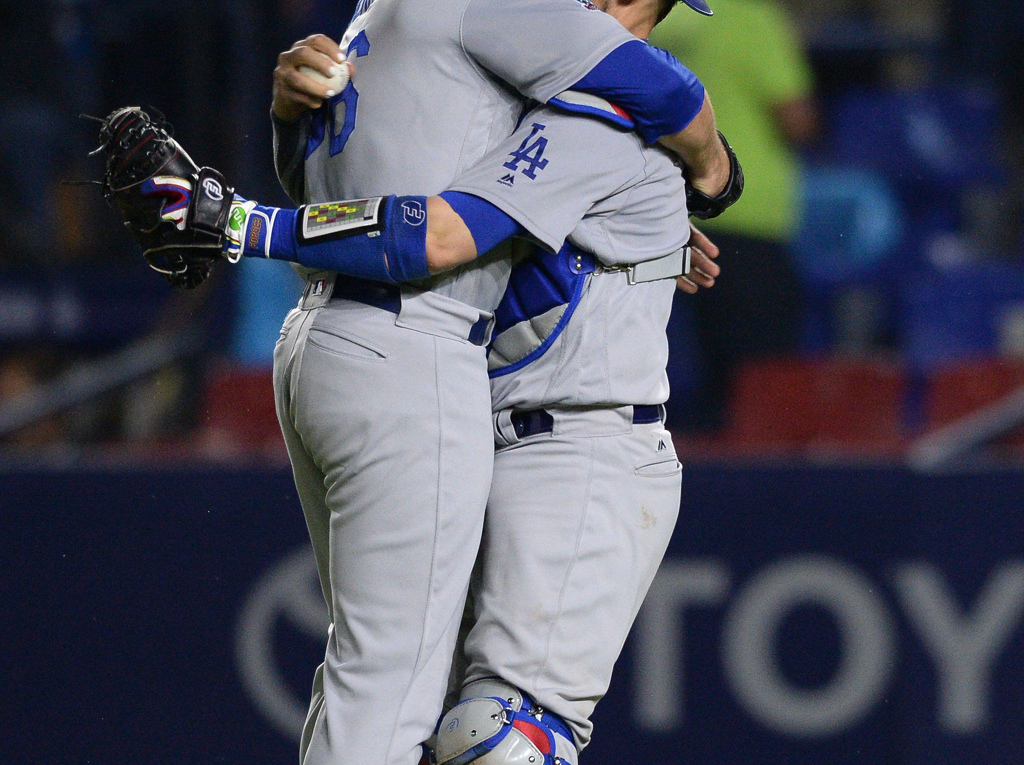 May 4: Los Angeles Dodgers relief pitcher Adam Liberatore (left) and catcher Yasmani Grandal (right) celebrate after recording the last out of a combined no-hitter against the San Diego Padres at Estadio de Beisbol Monterrey.
