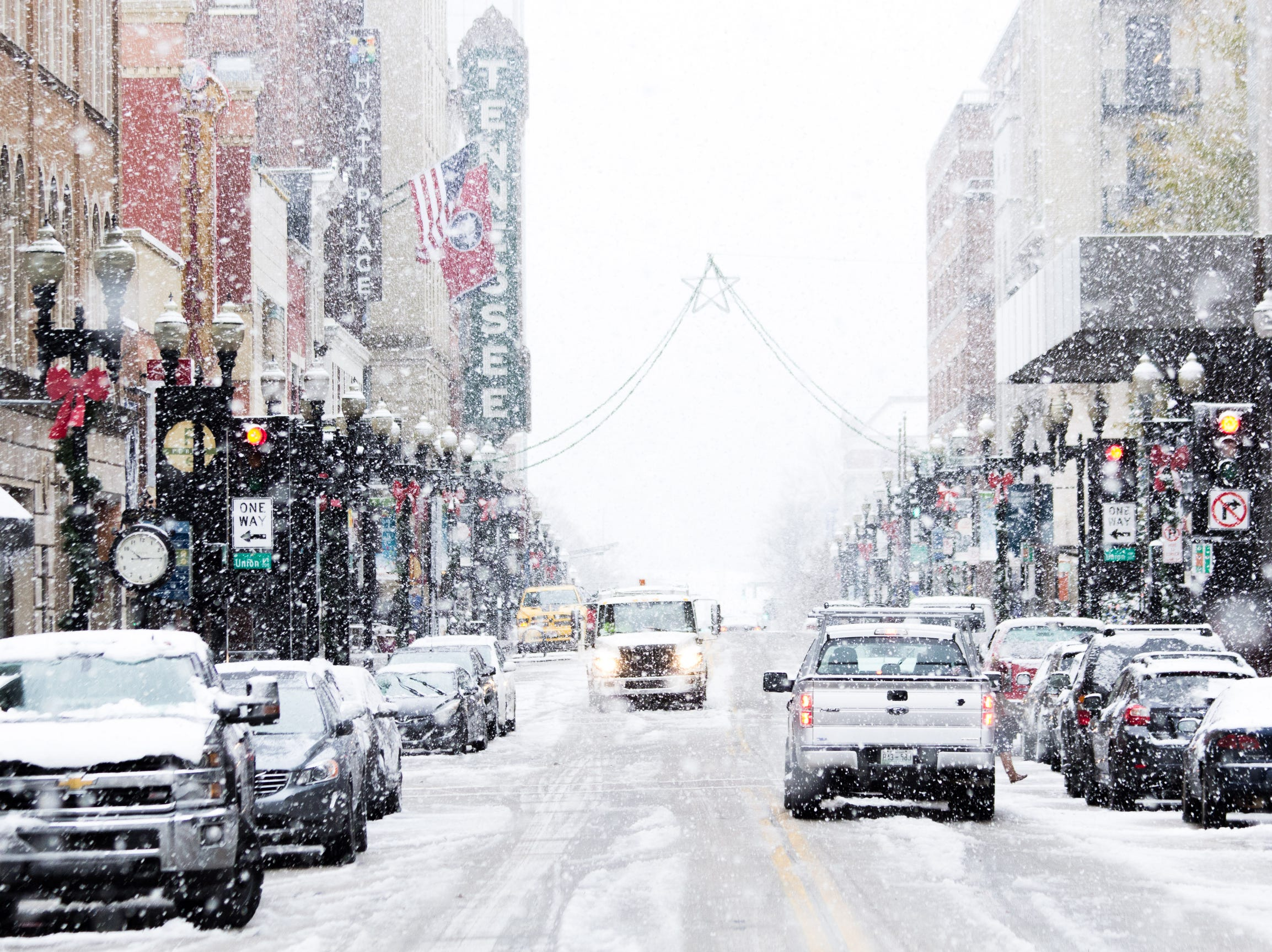 Snow flurries fall on Gay St. as Knoxville, Tenn., Sunday, receives the season's first snow fall.