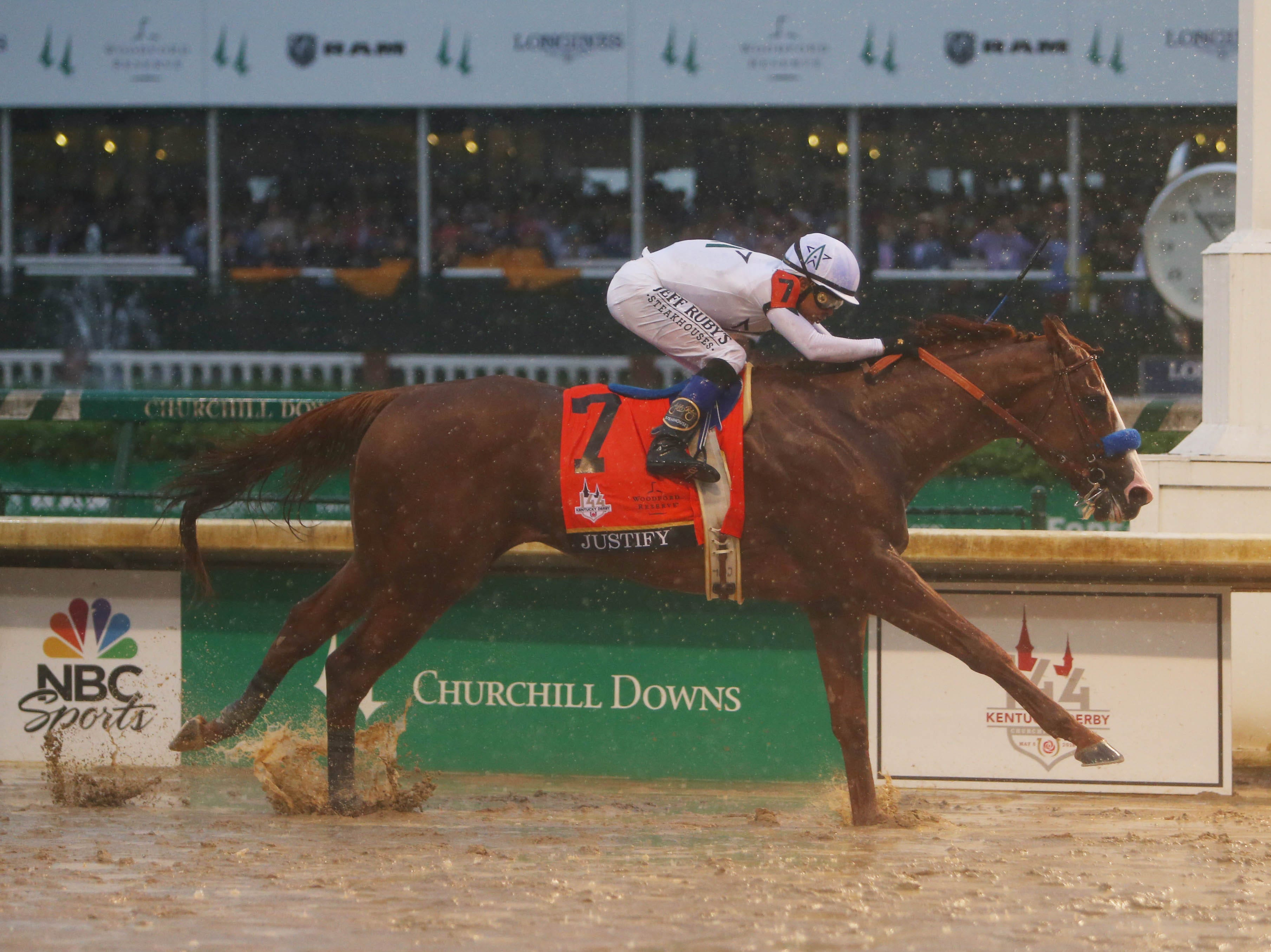 May 5: Mike Smith aboard Justify crosses the finish line to win the 144th Kentucky Derby at Churchill Downs.
