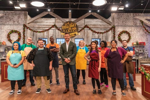 """Host Jesse Palmer leads a group of contestants on """"Holiday Baking Championship."""""""