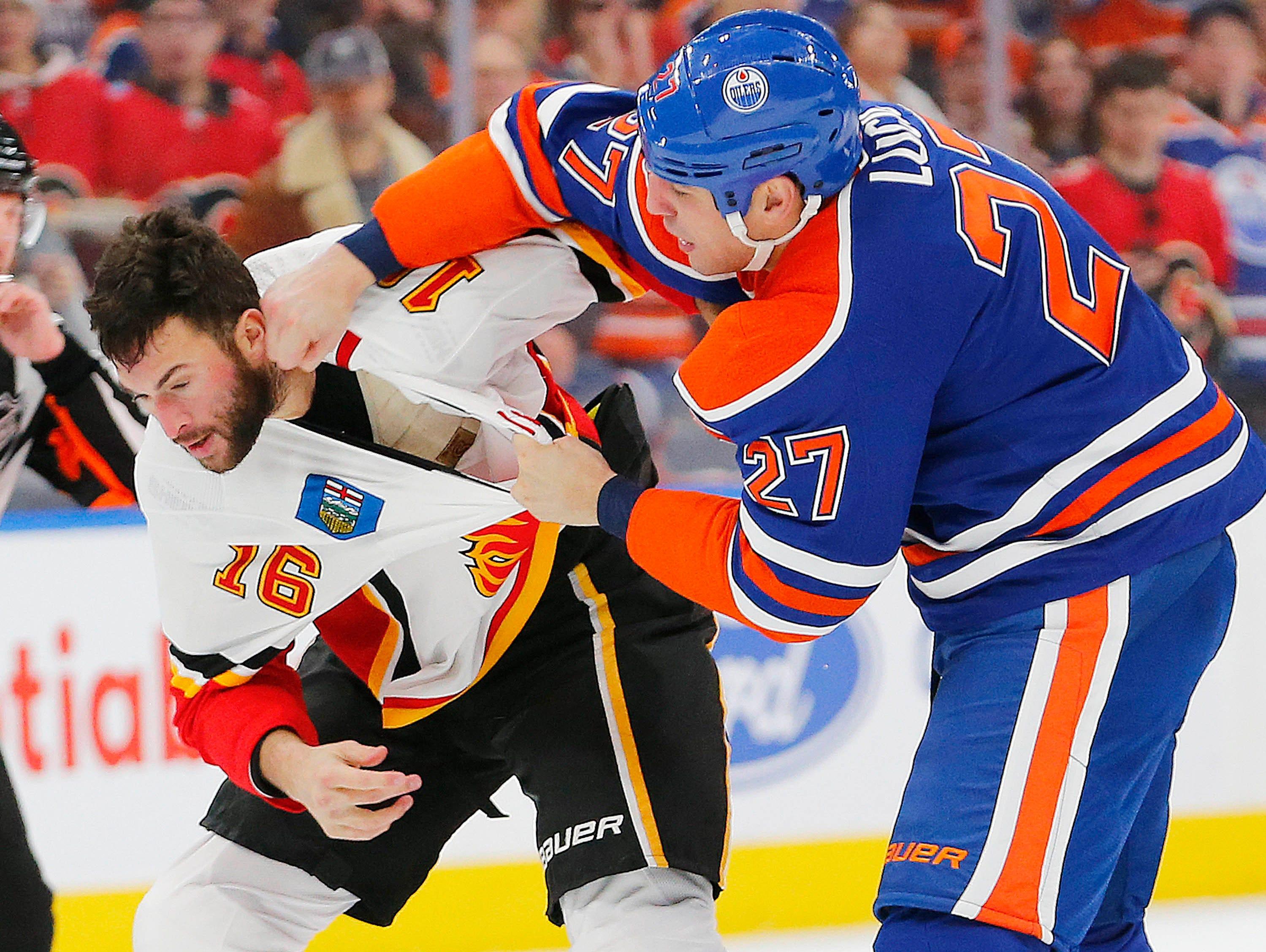Dec. 9: Calgary Flames' Anthony Peluso vs. Edmonton Oilers' Milan Lucic.