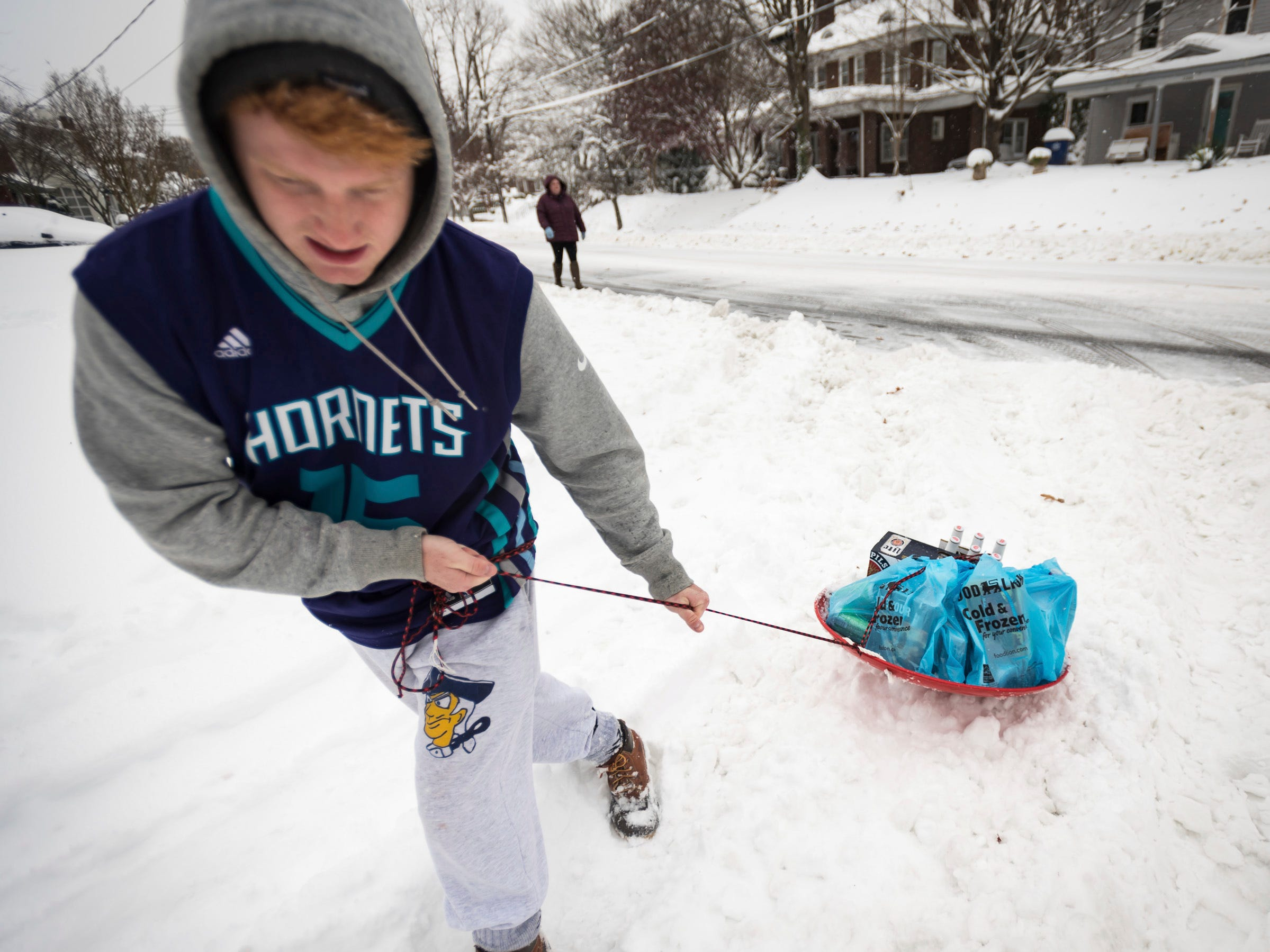 Daniel Havens struggles to pull a sled full of groceries tied to his waist on Dec. 9 in Winston-Salem, N.C.