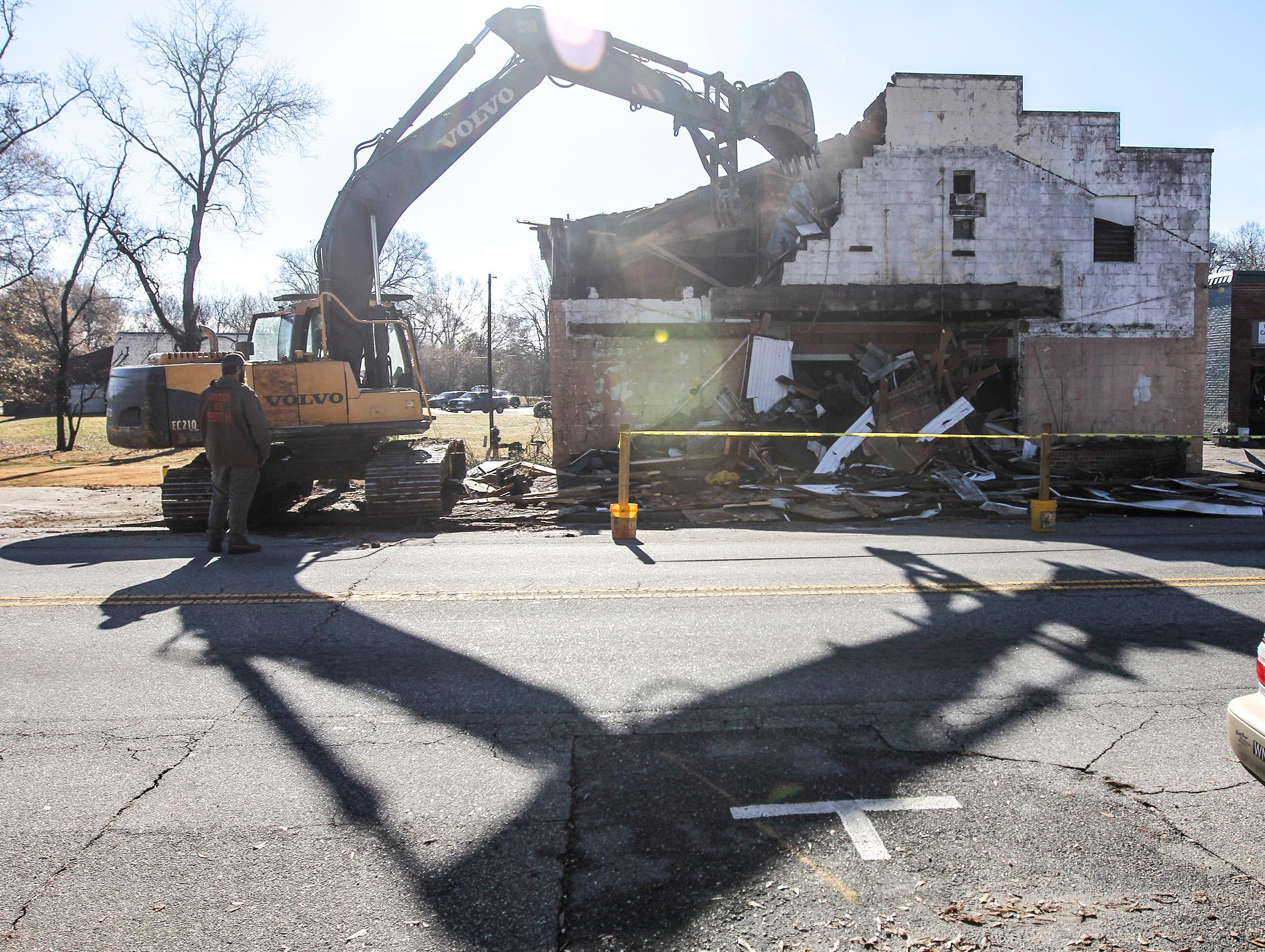 Hack Hammond of Pelzer demolishes the Williamston Theater in Williamston on Tuesday.