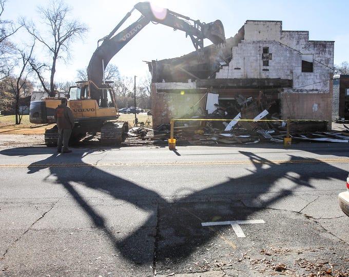 Hack Hammond of Pelzer demolishes the Williamston Theater in Williamston on Tuesday.