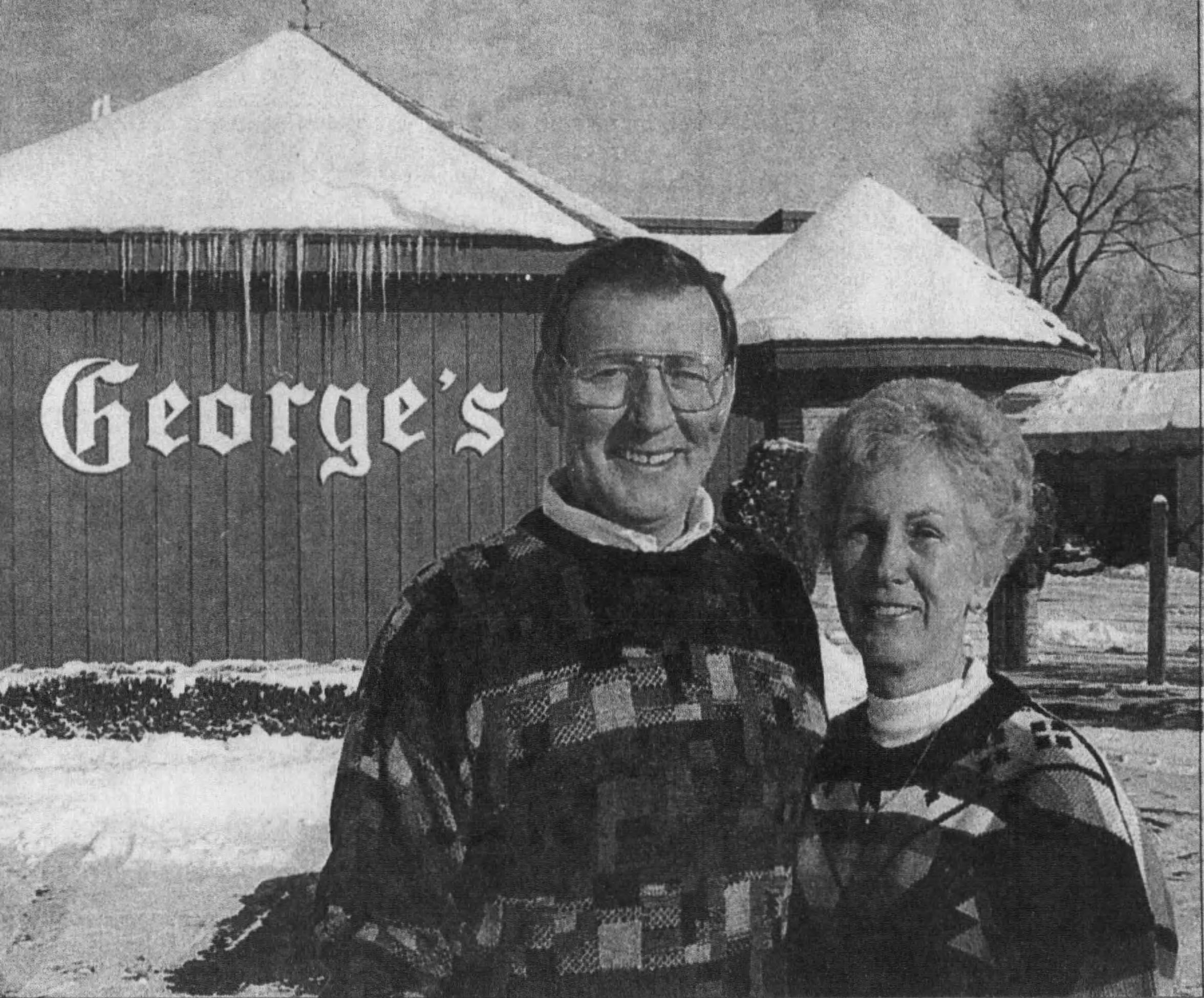 The Quimbys — Chuck, left, and the late Edie — bought George's Steak House in 1976. They're seen here in front of the restaurant in 1993.