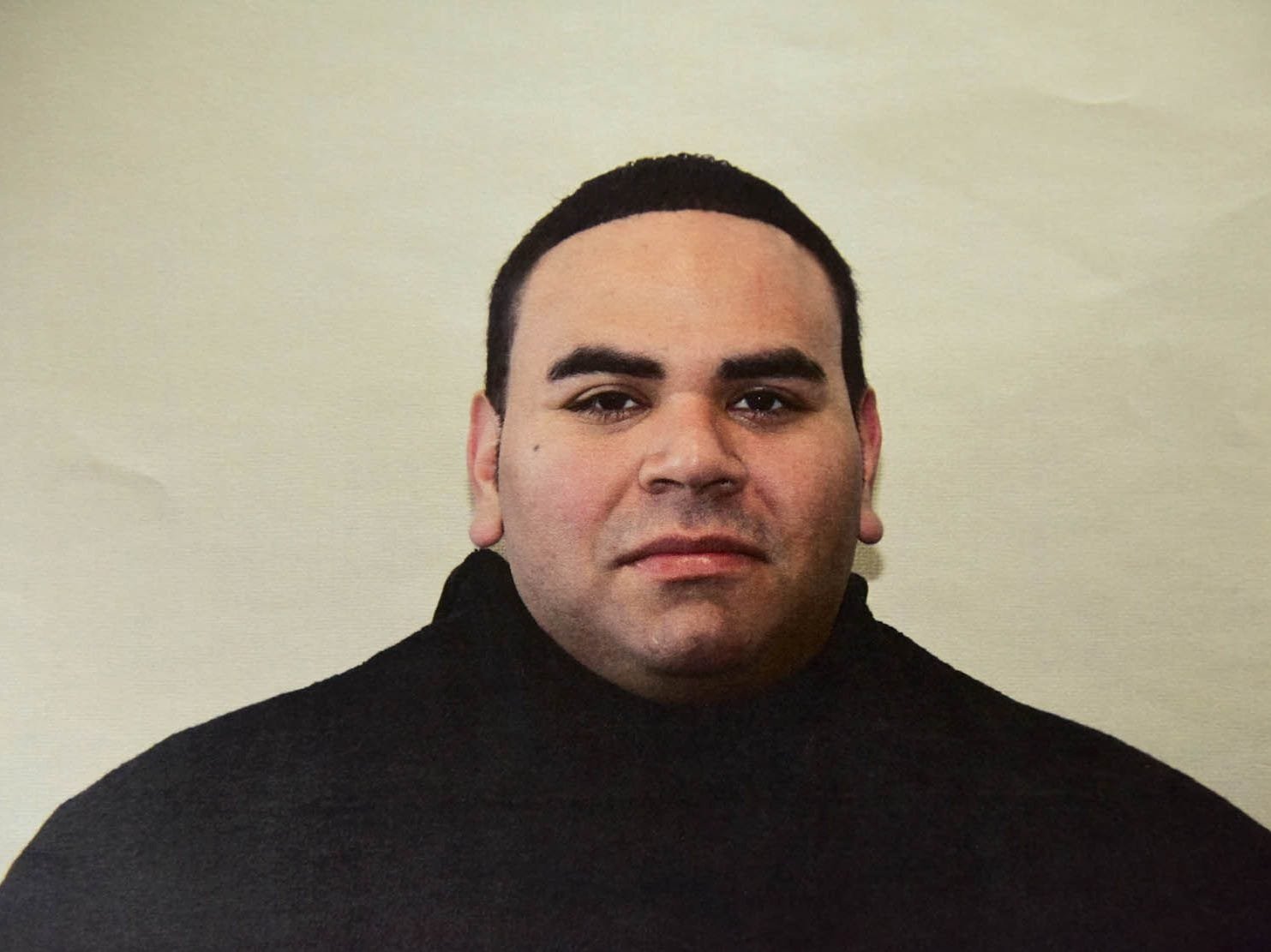 Paterson police officer Jonathan Bustios is charged with extortion and conspiracy to deprive persons of their human rights.