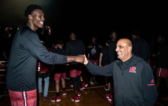 "Rutgers' 7-foot center Shaq Doorson (left) towers over Rutgers staffer Greg ""Shoes"" Vetrone at MidKnight Madness."