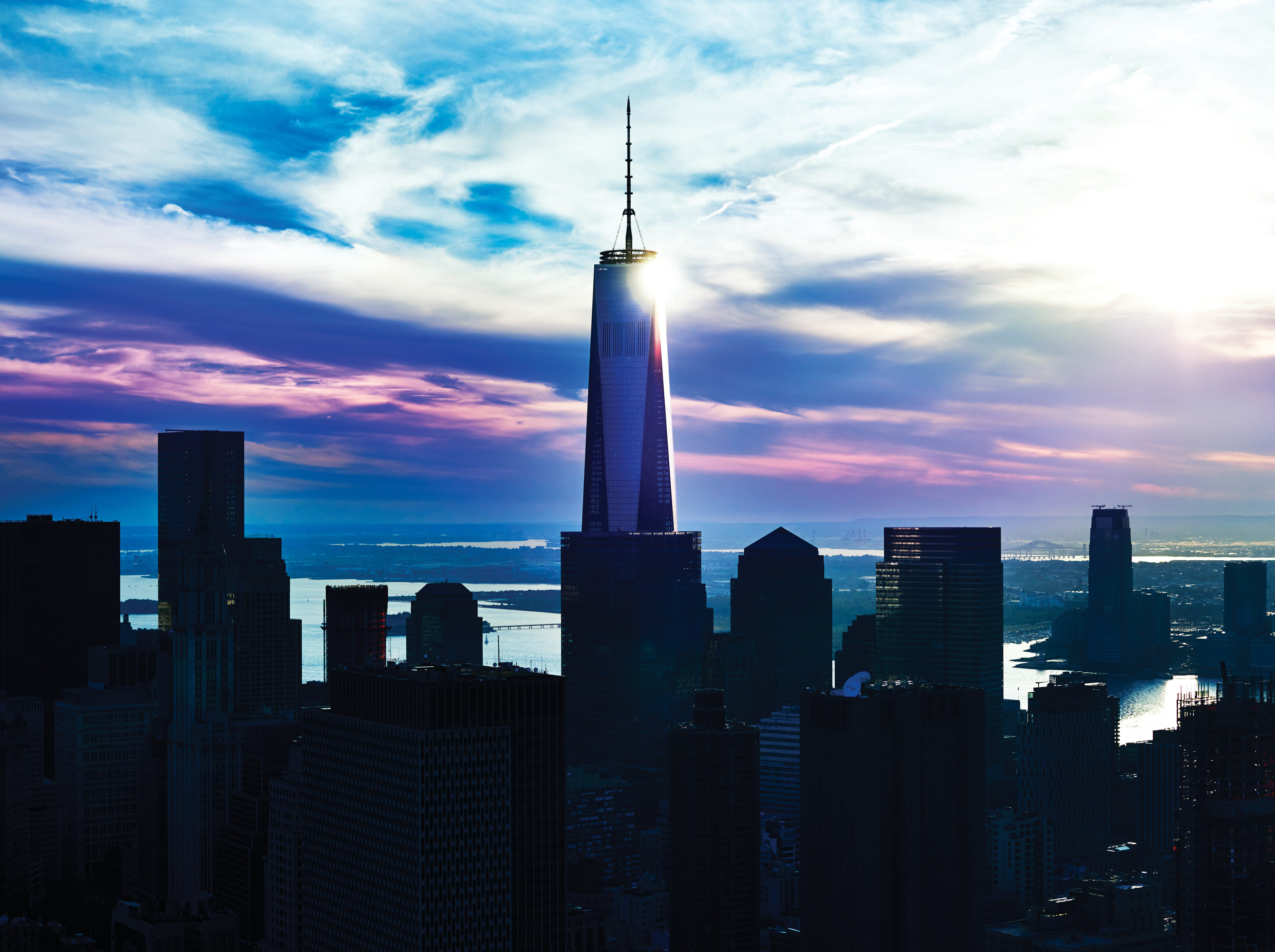 The sun glints off the wall of One World Trade Center in New York.