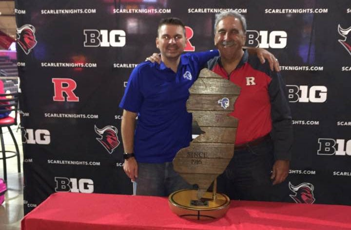 Richie and Don Lomurro standing behind the Boadwalk Trophy after the 2017 Garden State Hardwood Classic at the RAC.
