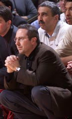 Don Lomurro. top right, of Freehold watches over the shoulder of Rutgers head coach Kevin Bannon as the Pirates take on Seton Hall in 2001.