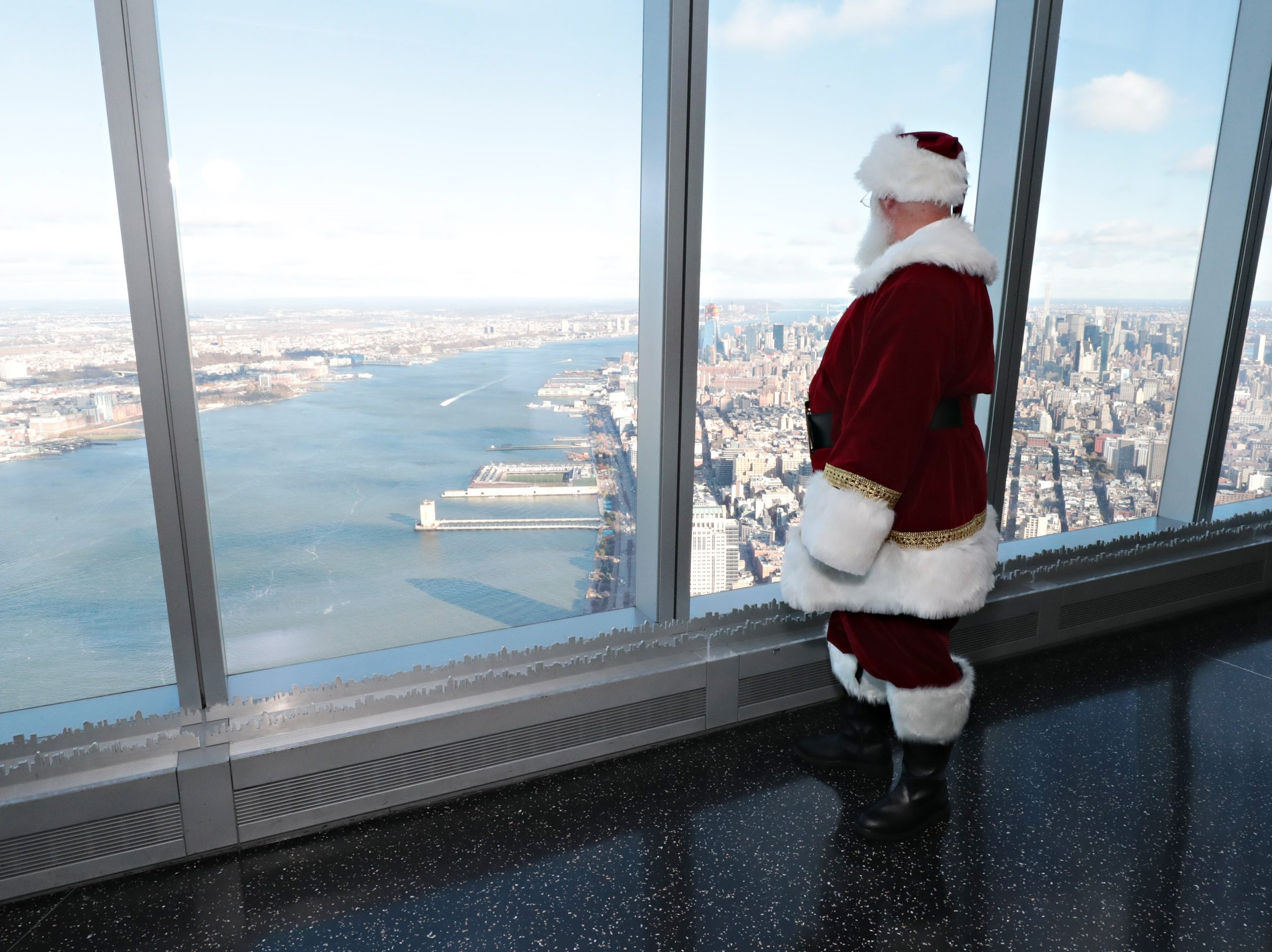 Santa Claus takes in the view from One World Observatory.