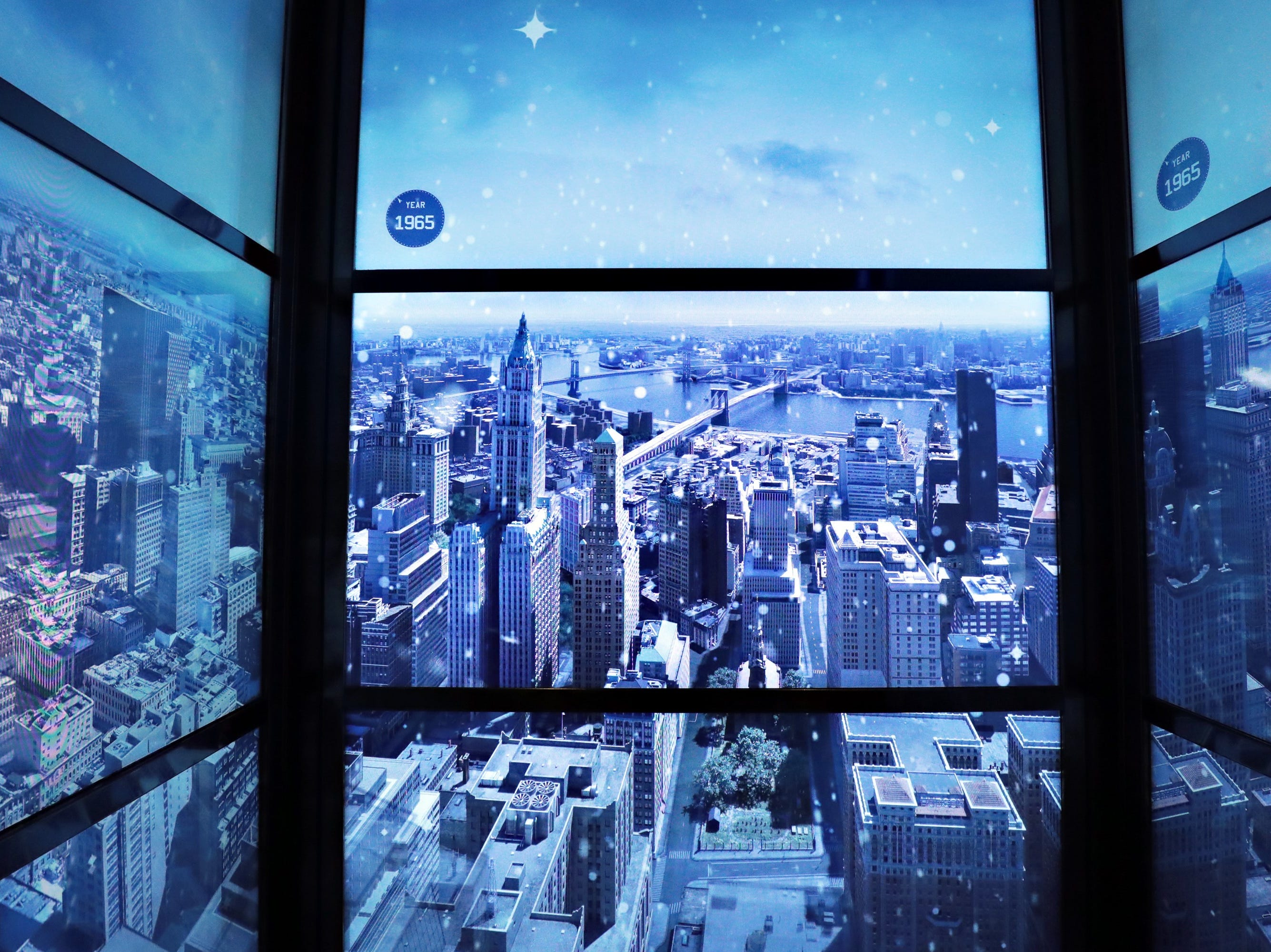 One of the best parts of visiting One World Observatory is watching the timeline in the Sky Pod elevator, decorated with snow for the holidays.