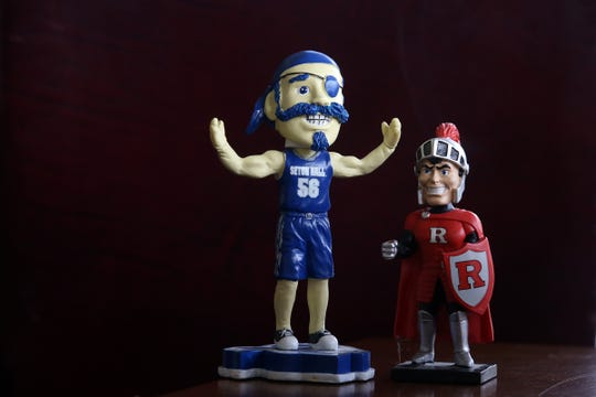 Don and Richie Lomurro's Seton Hall and Rutgers bobbleheads.