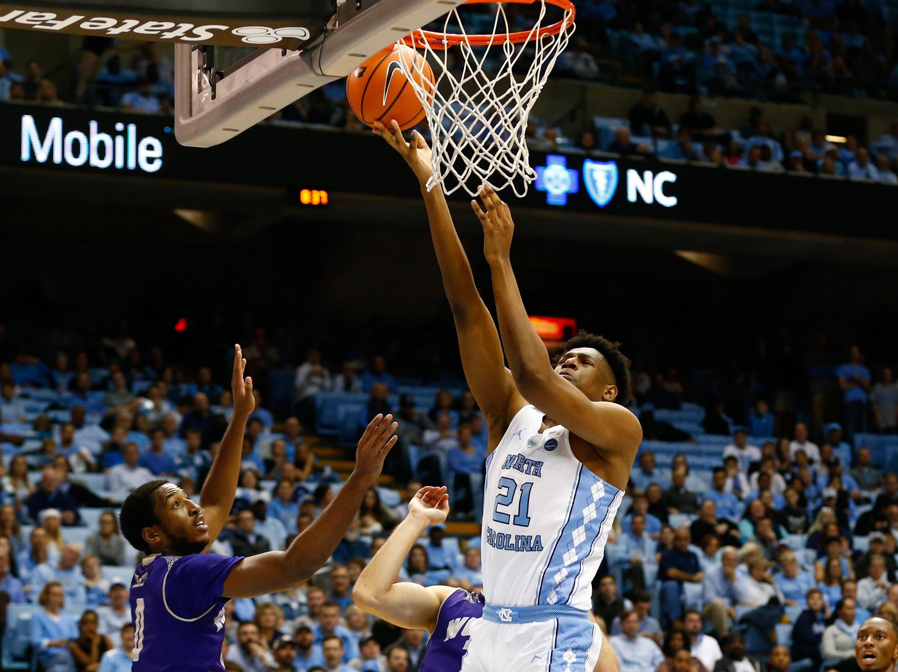 Dec 6, 2017; Chapel Hill, NC, USA; North Carolina Tar Heels forward Sterling Manley (21) shoots the ball against Western Carolina Catamounts guard Maurice Smith (0) in the first half at Dean E. Smith Center. Mandatory Credit: Jeremy Brevard-USA TODAY Sports