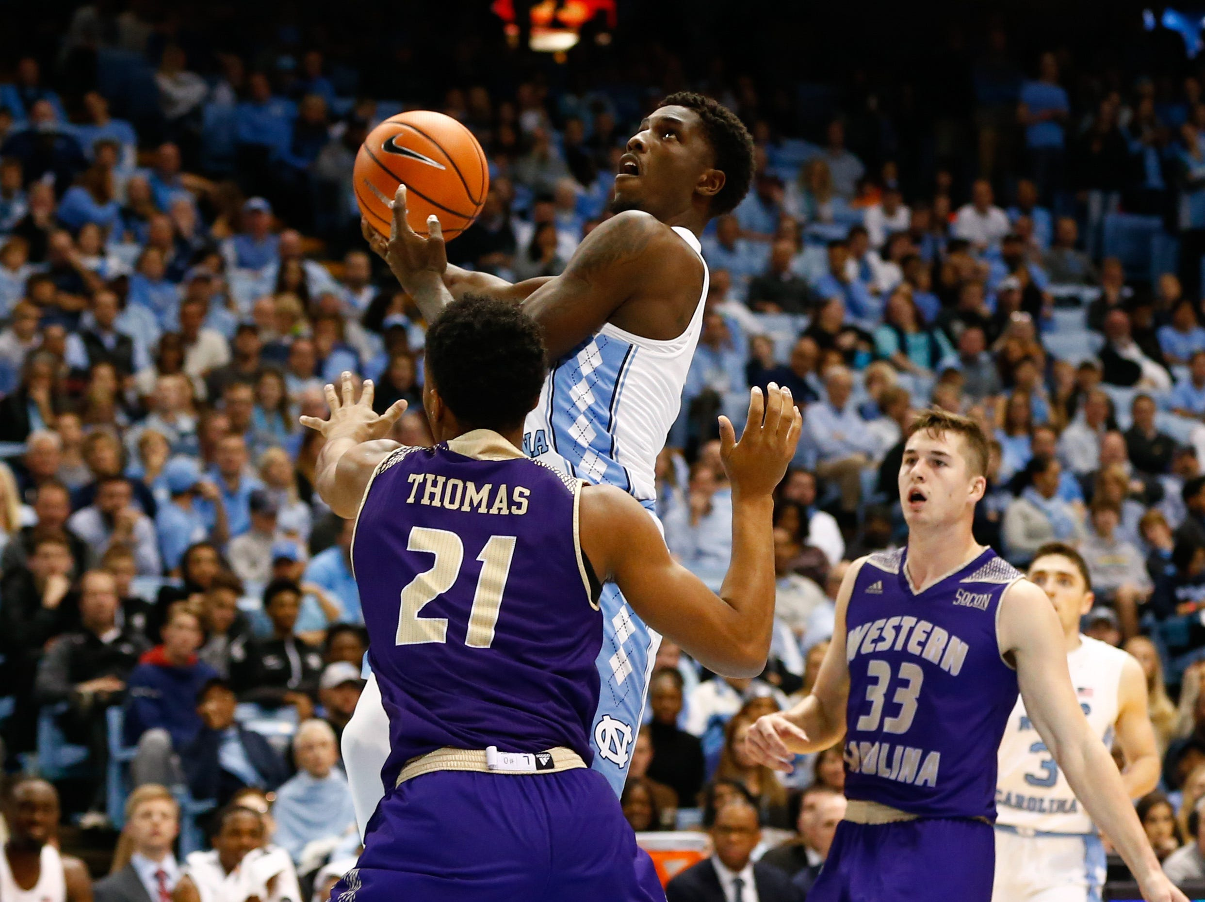 Dec 6, 2017; Chapel Hill, NC, USA; North Carolina Tar Heels guard Jalek Felton (5) goes up for a shot against Western Carolina Catamounts guard Marcus Thomas (21) in the second half at Dean E. Smith Center. Mandatory Credit: Jeremy Brevard-USA TODAY Sports