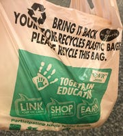 Harris Teeter, whose bag is pictured here, says it will phase out single-use plastic bags by 2025.