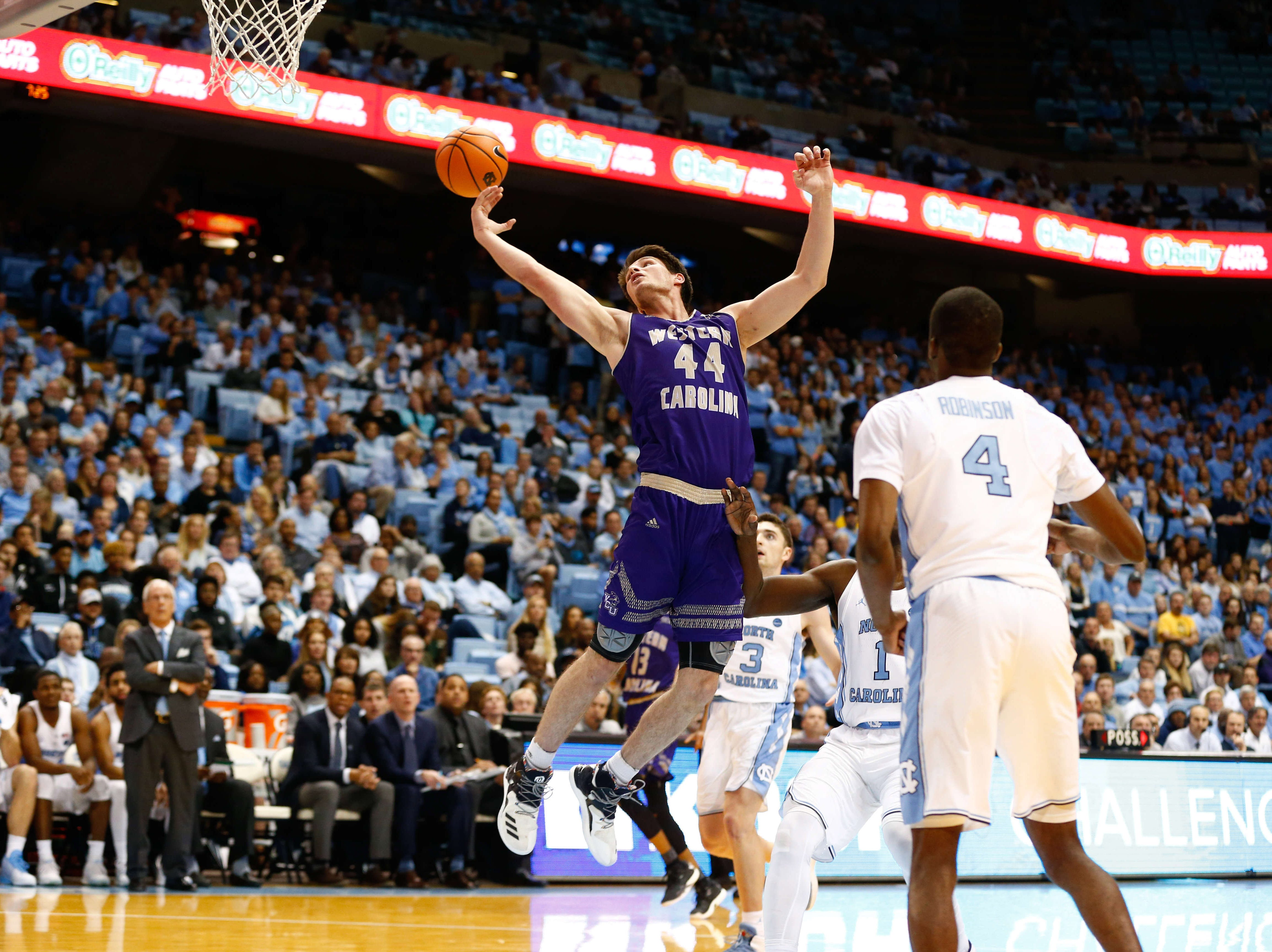 Dec 6, 2017; Chapel Hill, NC, USA; Western Carolina Catamounts forward Adam Sledd (44) tries to save an overthrown pass in the first half against the North Carolina Tar Heels at Dean E. Smith Center. Mandatory Credit: Jeremy Brevard-USA TODAY Sports